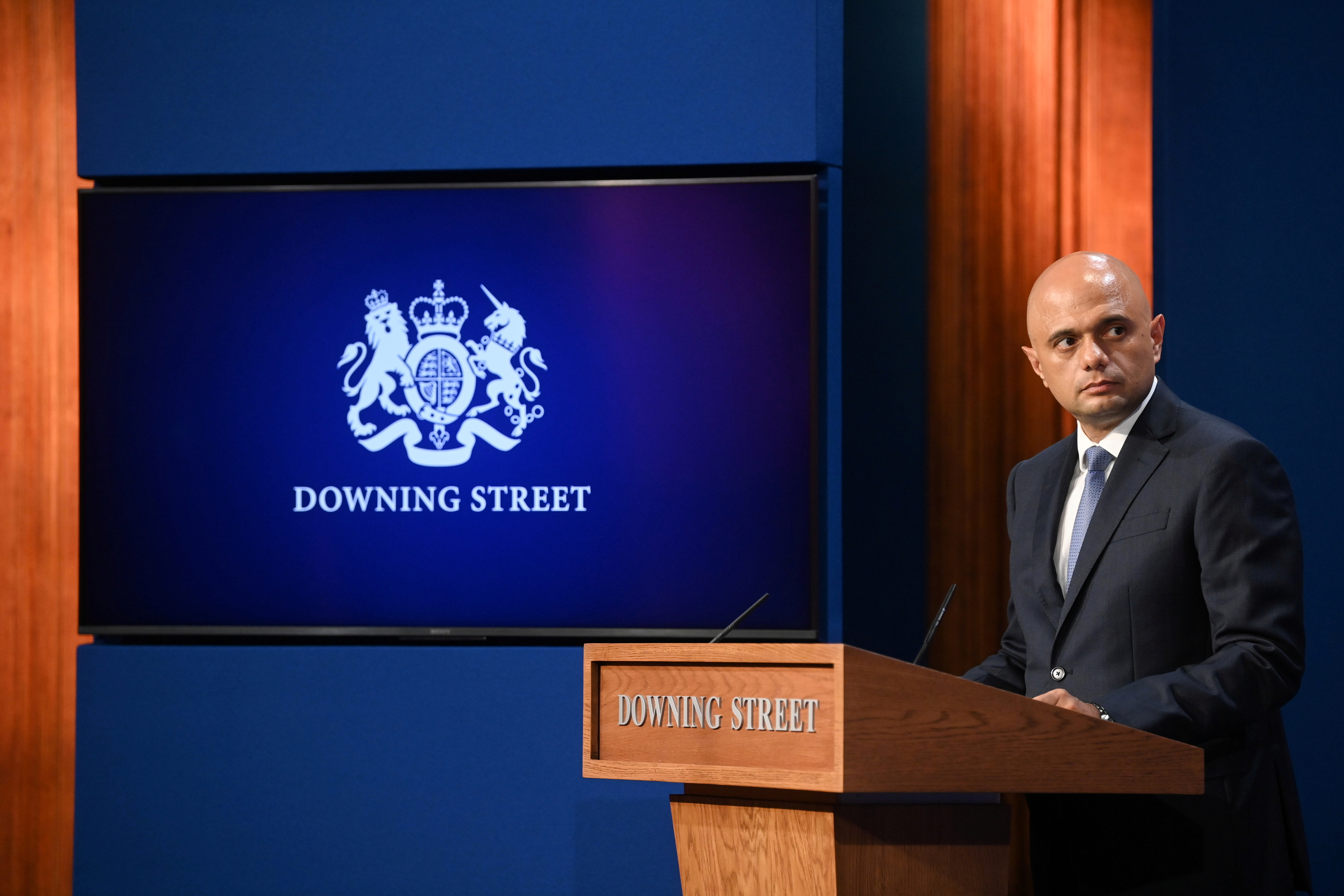 Britain's Health Secretary Sajid Javid looks on during a news conference with Britain's Prime Minister Boris Johnson and Britain's Chancellor of the Exchequer Rishi Sunak, in Downing Street, in London, Britain, September 7, 2021. REUTERS/Toby Melville/Pool/File Photo