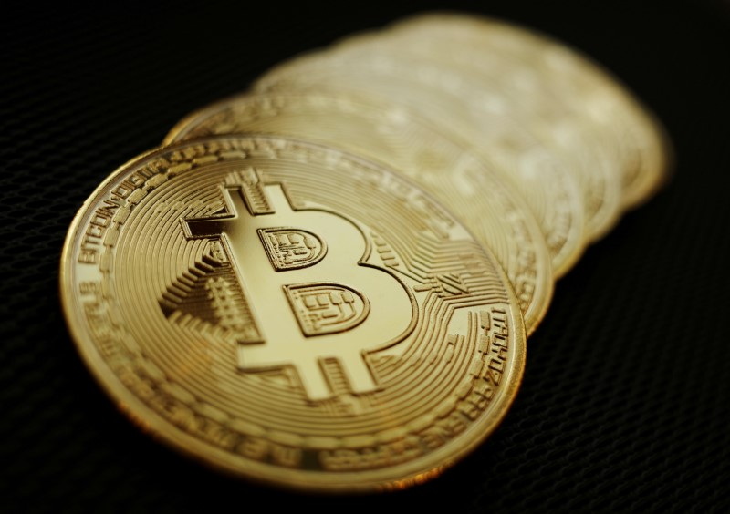 Representations of the Bitcoin cryptocurrency are seen in this illustration picture taken June 7, 2021.   REUTERS/Edgar Su/Illustration/File Photo