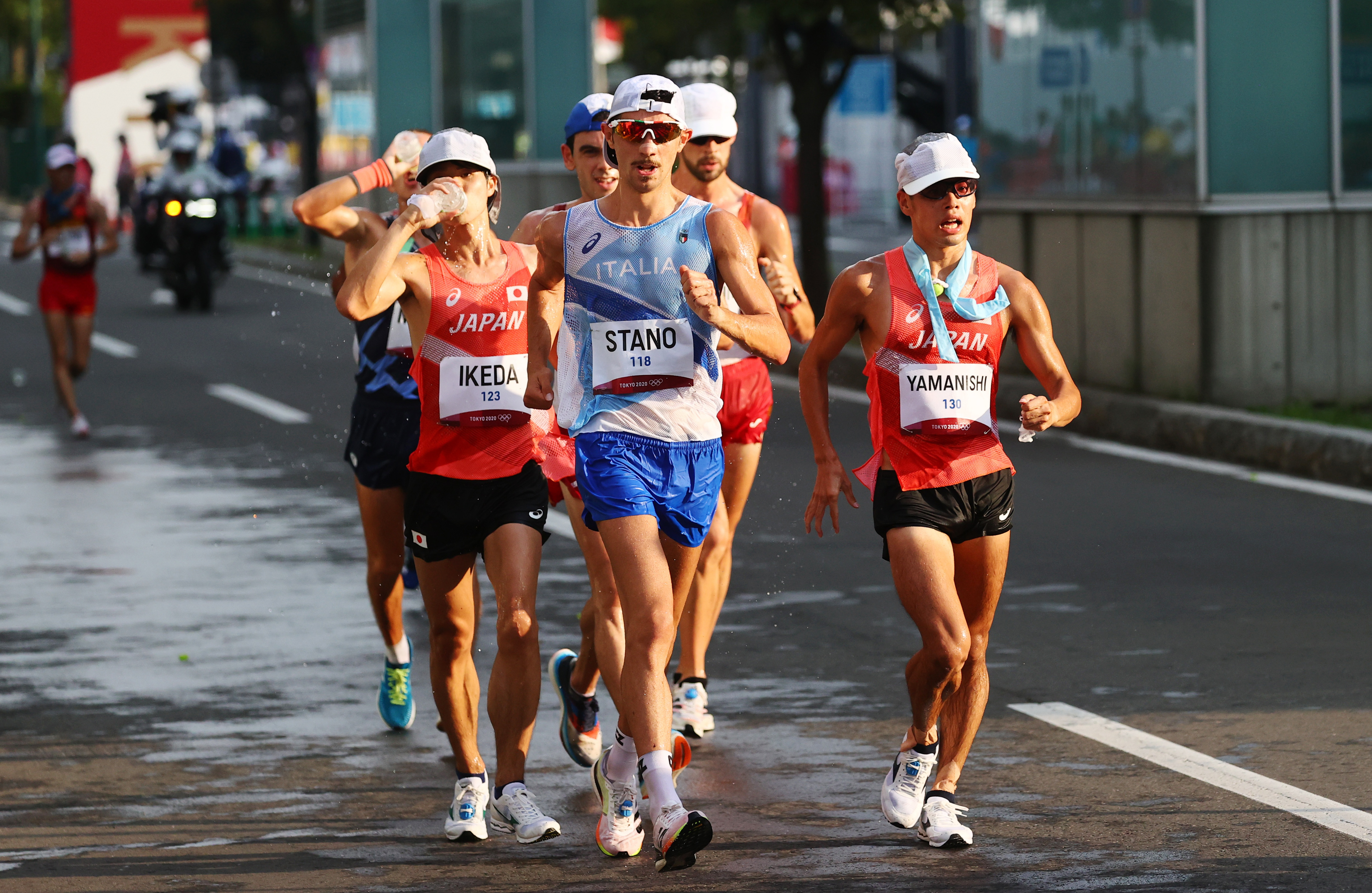 Tokyo 2020 Olympics - Athletics - Men's 20km Walk - Sapporo Odori Park, Sapporo, Japan - August 5, 2021. Massimo Stano of Italy and Toshikazu Yamanishi of Japan in action during competing REUTERS/Kim Hong-Ji