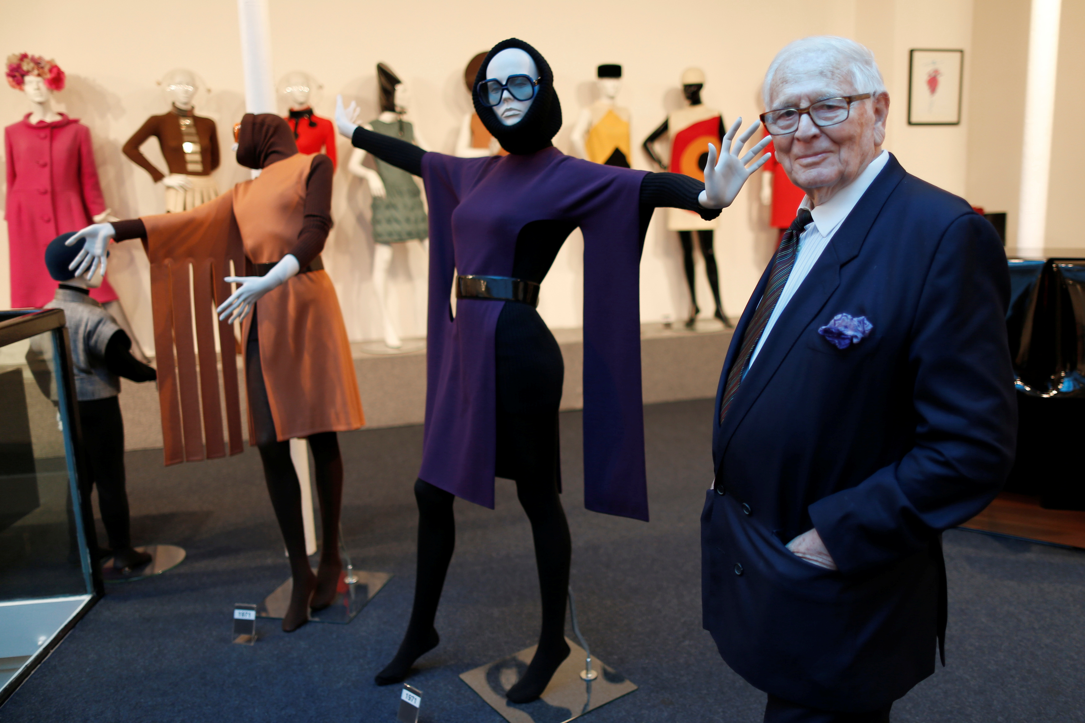 French fashion designer Pierre Cardin poses in front of his fashion creations in his museum called
