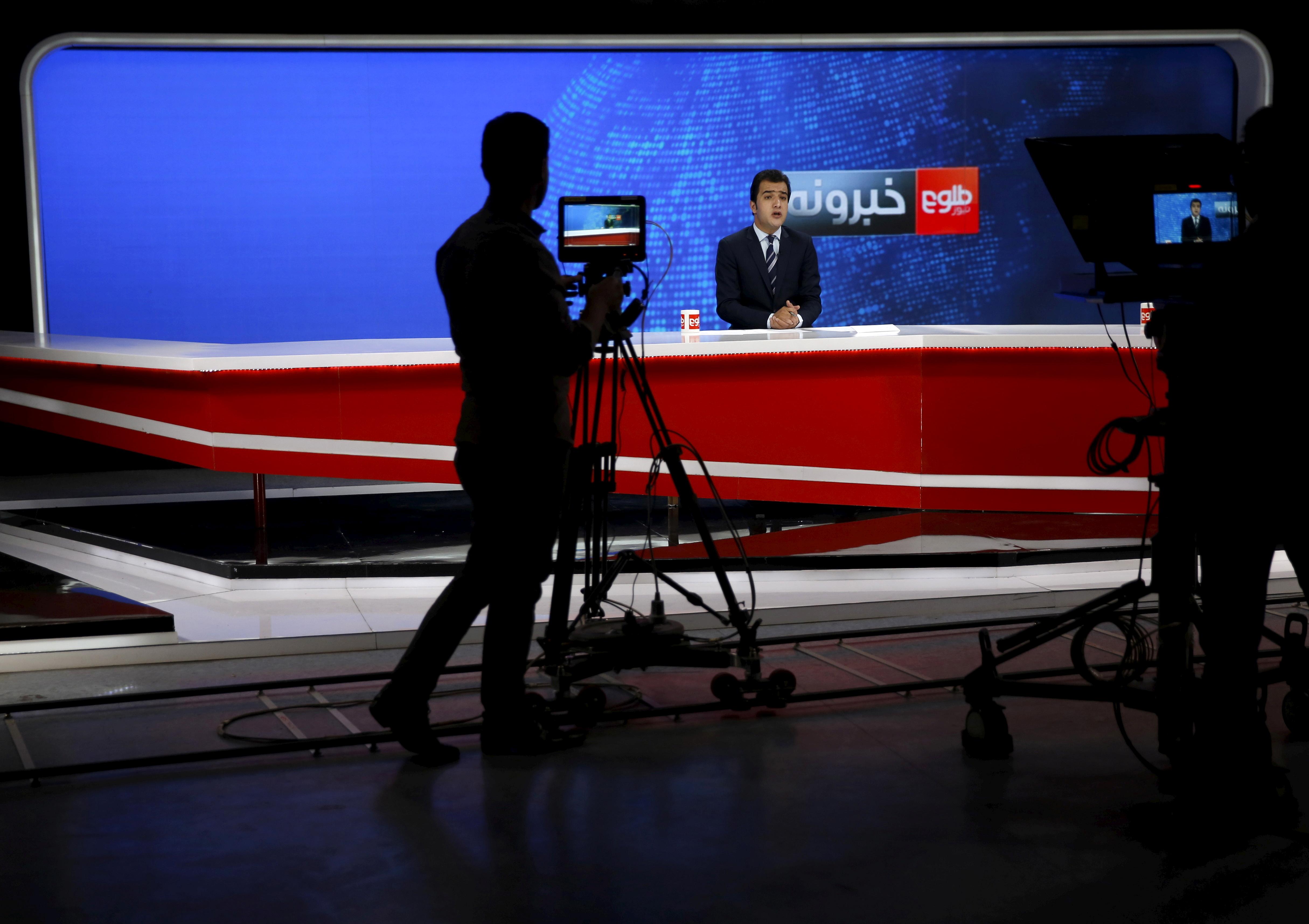 A cameraman films a news anchor at Tolo News studio, in Kabul, Afghanistan October 18, 2015. REUTERS/Ahmad Masood