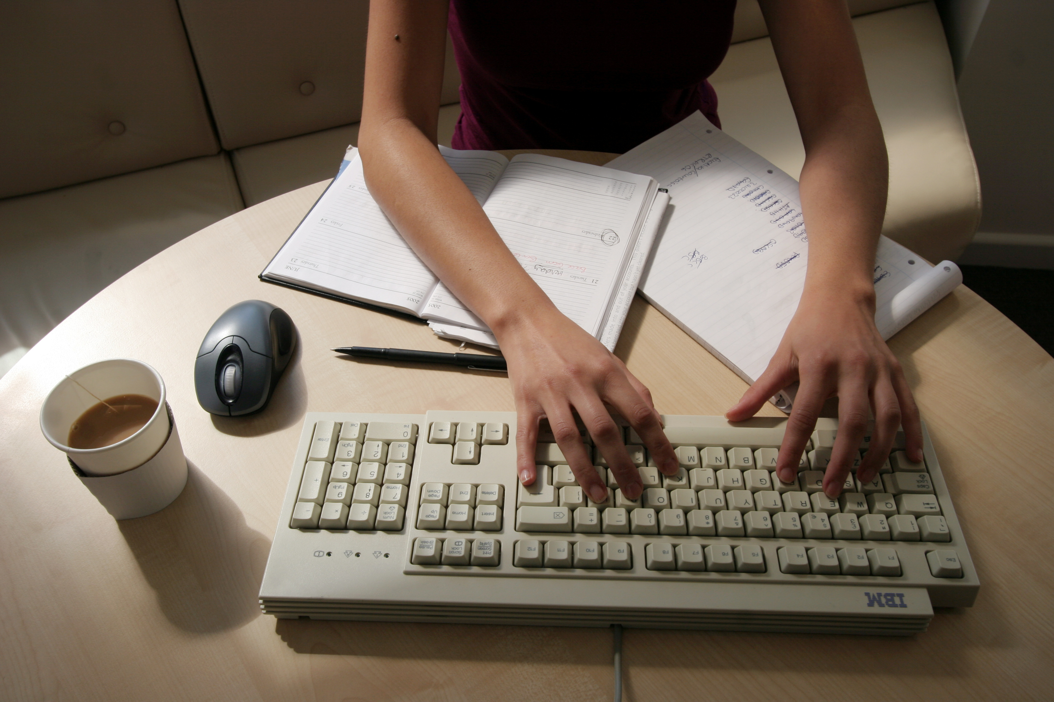 A woman works at her desk typing on a computer in this illustration picture taken January 9, 2005, REUTERS/Catherine Benson