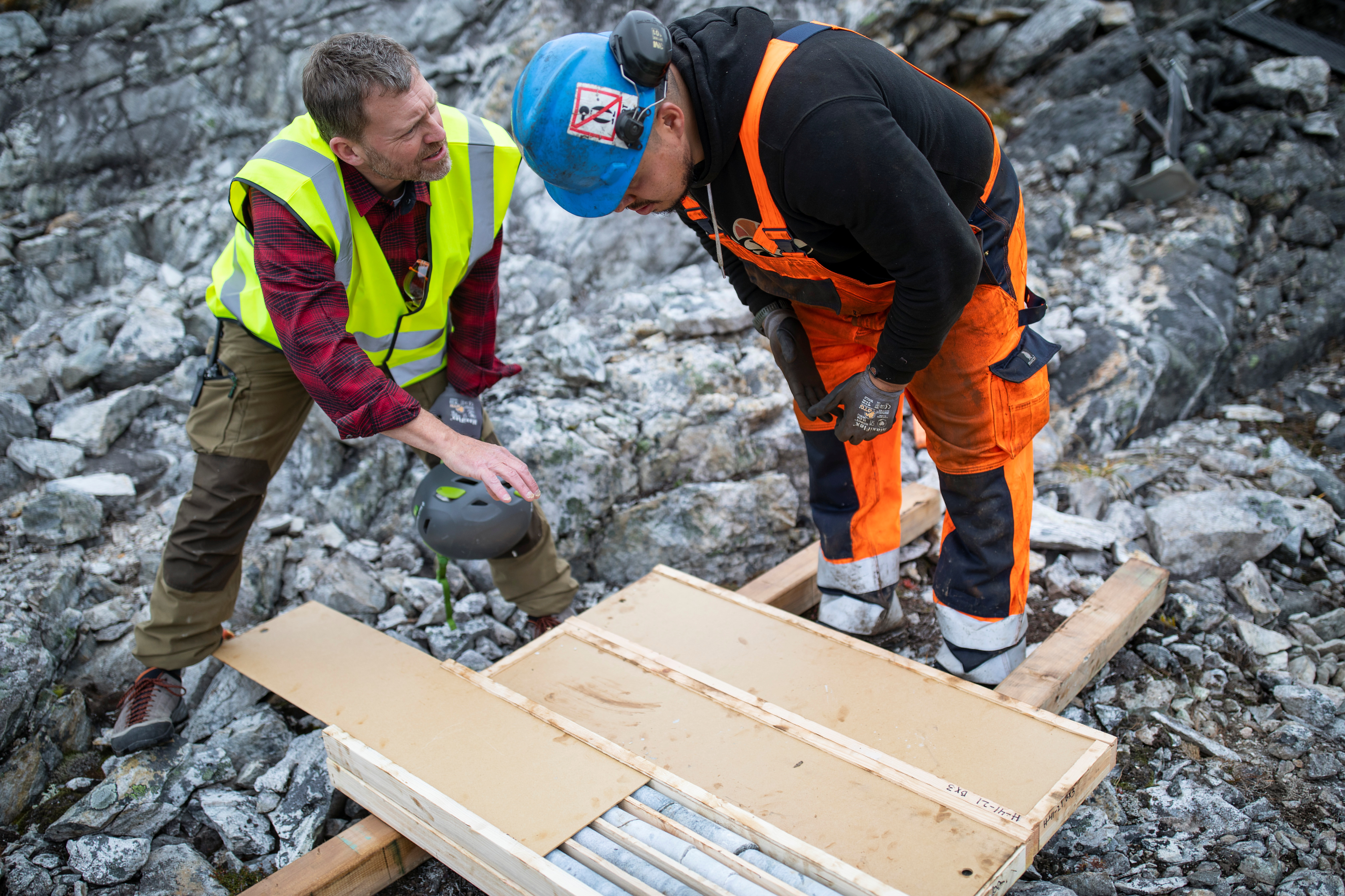 Geologist Anders Norby-Lie of the company Greenland Anorthosite Mining checks drilling cores at an exploration site of an anorthosite deposit close to the Qeqertarsuatsiaat fjord, Greenland, September 11, 2021.  REUTERS/Hannibal Hanschke
