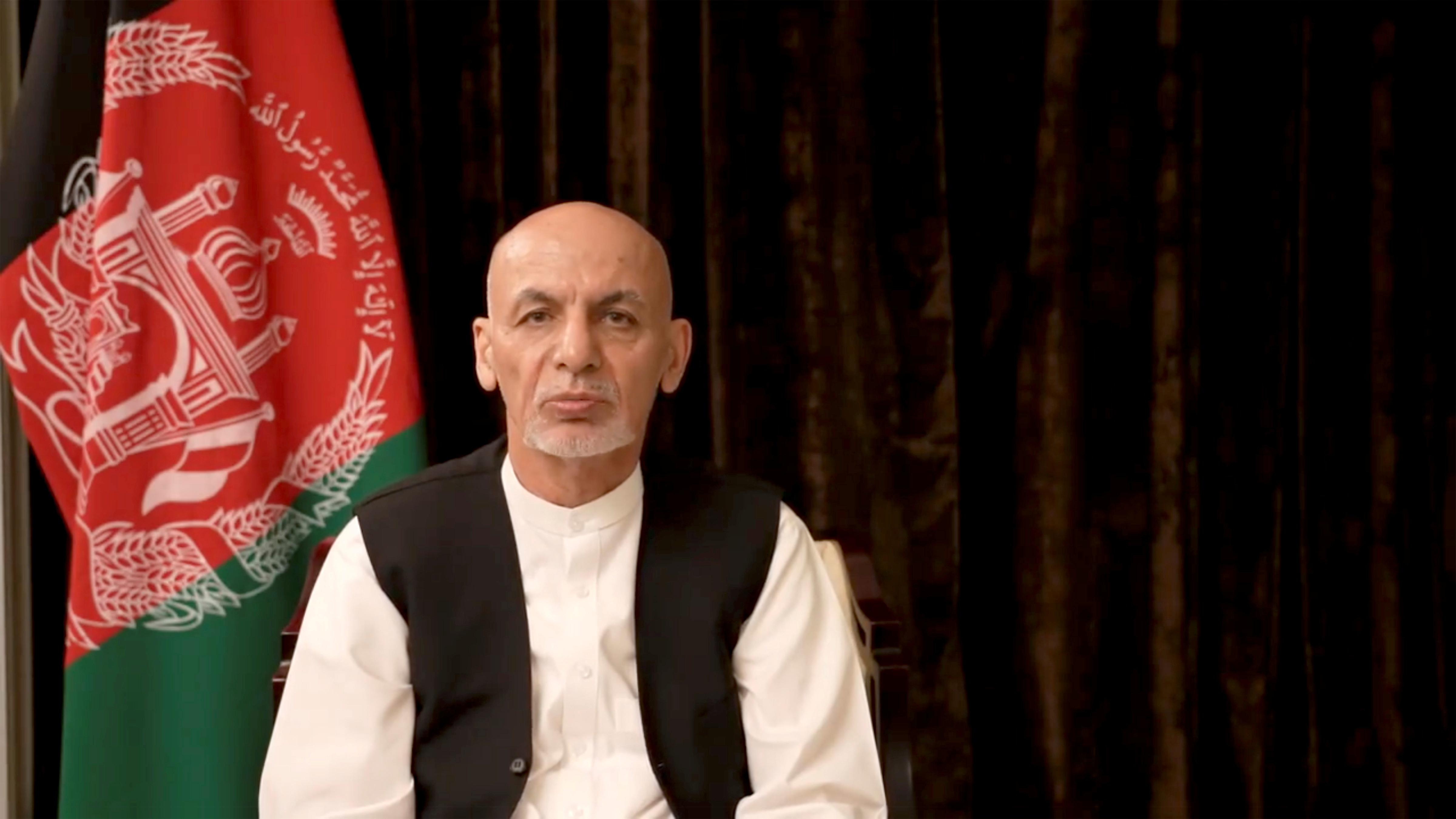 Afghan President Ashraf Ghani makes an address about the latest developments in the country from exile in United Arab Emirates, in this screen grab obtained from a social media video on August 18, 2021. Facebook/Ashraf Ghani/via REUTERS