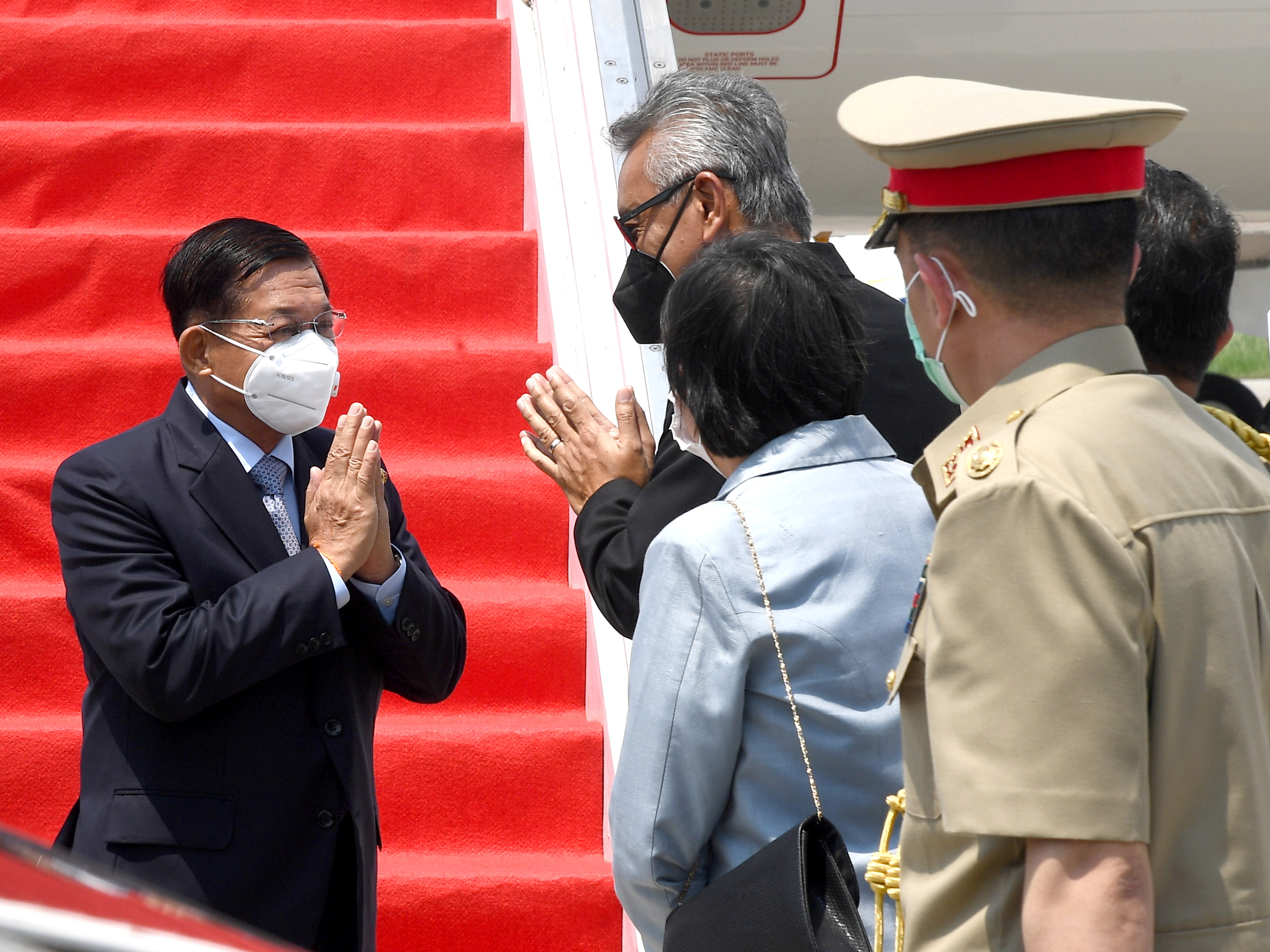 Myanmar's junta chief Senior General Min Aung Hlaing (L) gestures as he is welcomed upon his arrival ahead of the ASEAN leaders' summit, at the Soekarno Hatta International airport in Tangerang, on the outskirts of Jakarta, Indonesia, April 24, 2021. Courtesy of Rusman/Indonesian Presidential Palace/Handout via REUTERS