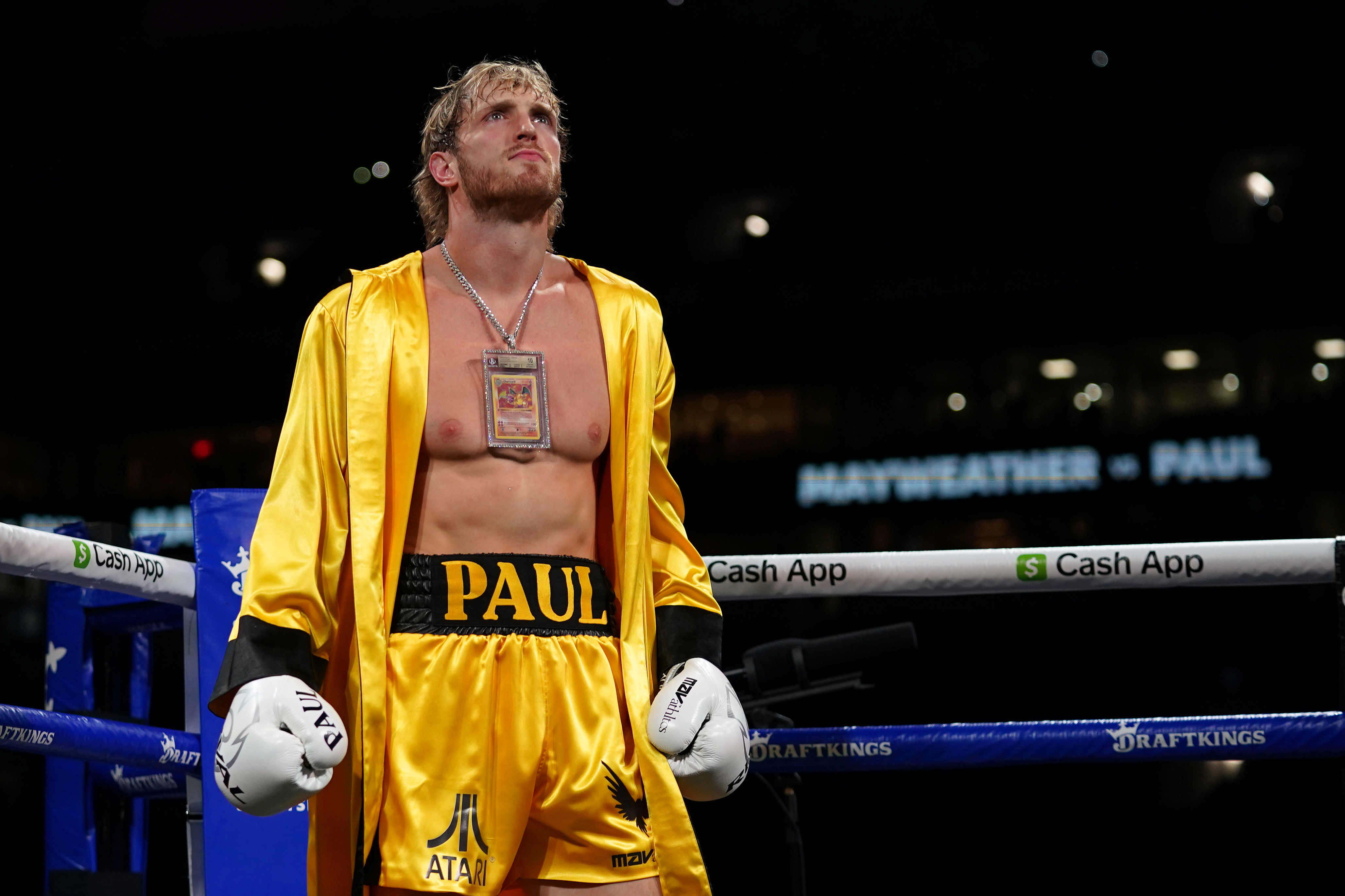 Jun 6, 2021; Miami, Florida, USA; Logan Paul (Yellow Trunks) stands in the ring prior to an exhibition boxing match against Floyd Mayweather Jr. (not pictured) at Hard Rock Stadium. Mandatory Credit: Jasen Vinlove-USA TODAY Sports/File Photo