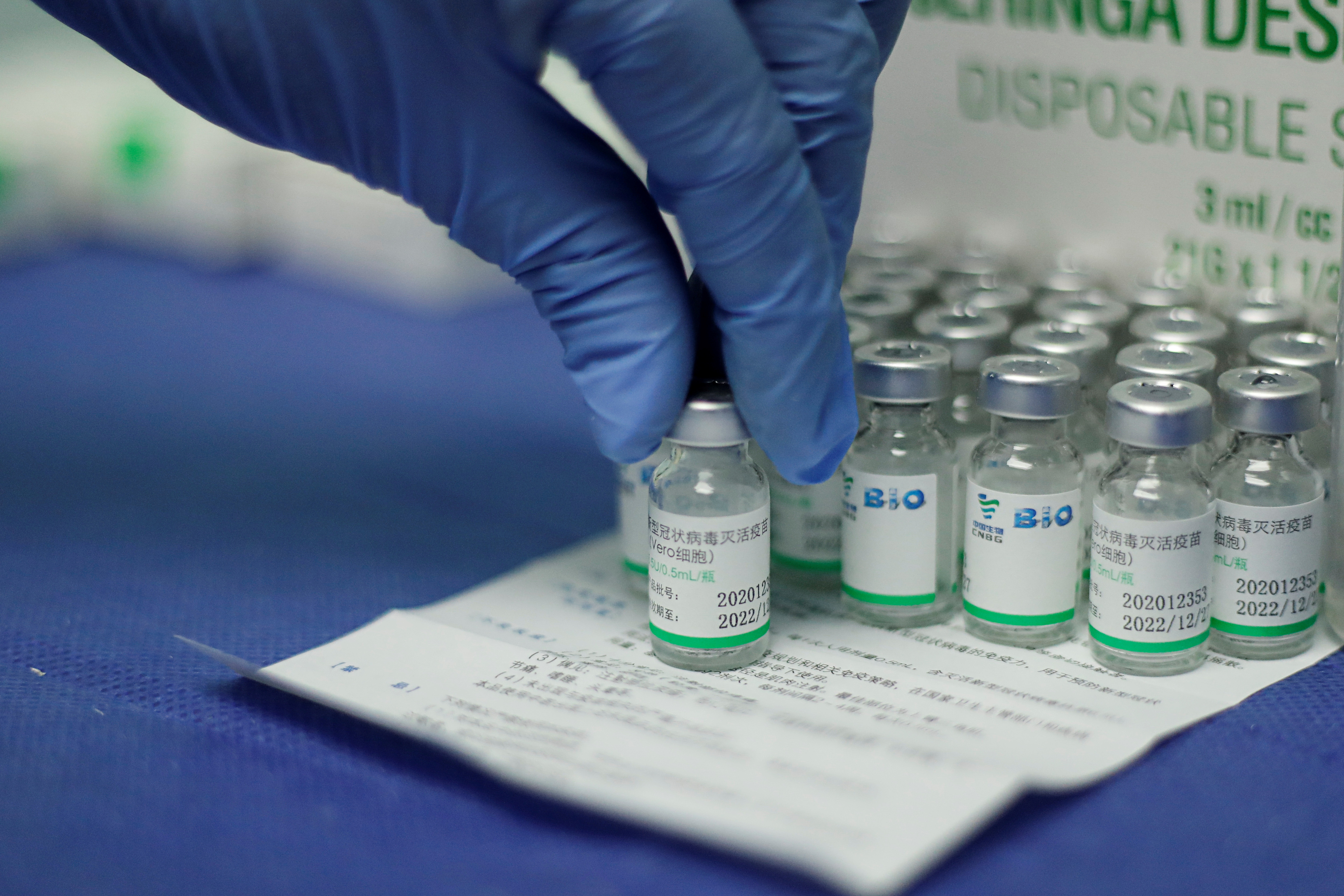 A nurse holds a vial of China's Sinopharm coronavirus disease (COVID-19) vaccine at a health center in Caracas, Venezuela March 7, 2021. REUTERS/Leonardo Fernandez Viloria