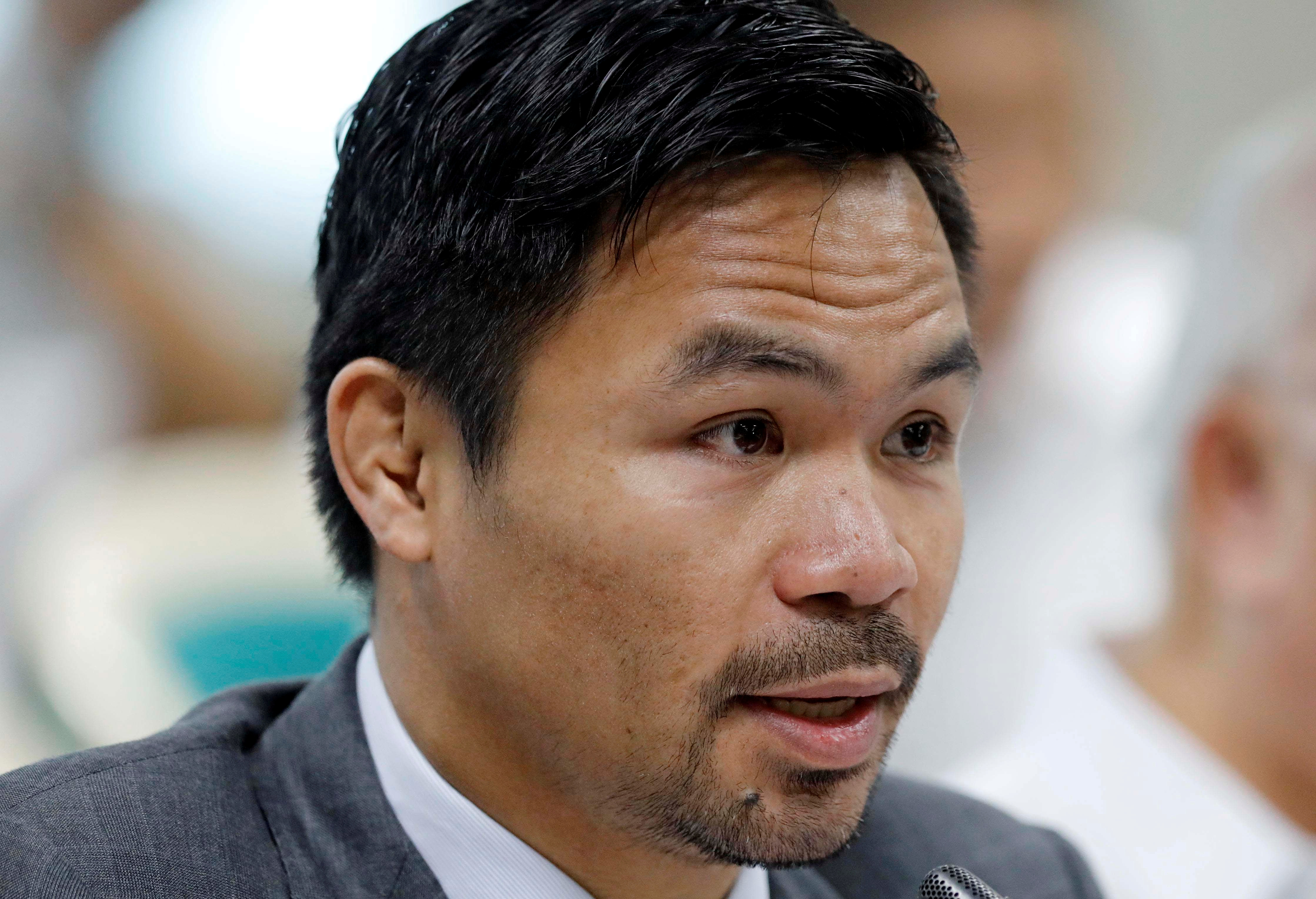 Philippine Senator and boxer Manny Pacquiao speaks during the Congressional confirmation hearing of Environment Secretary Regina Lopez at the Senate in Manila, Philippines May 2, 2017.  REUTERS/Erik De Castro/File Photo