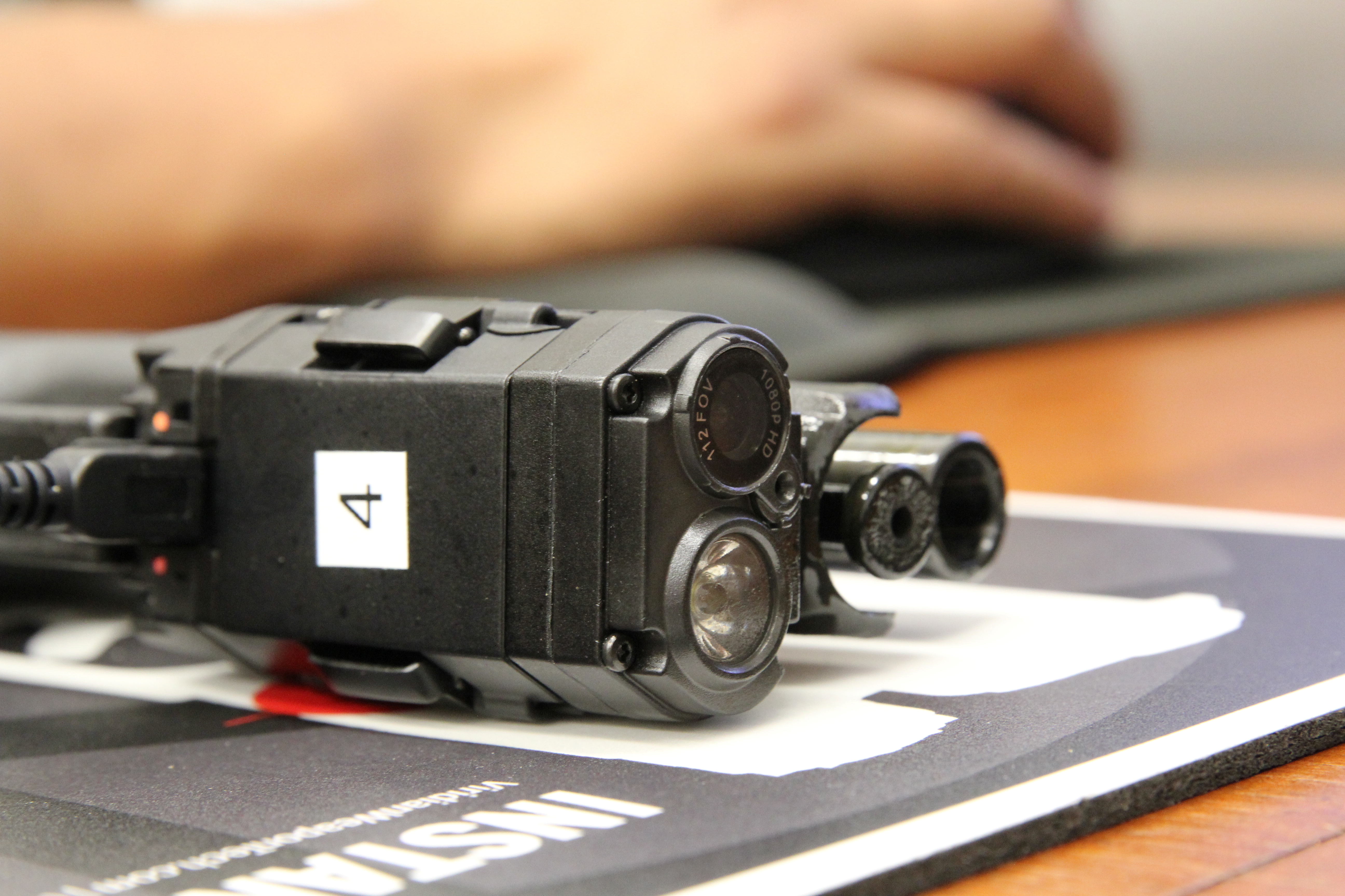 The battery, lens and light of a Viridian FACT Duty weapon-mounted camera are seen on the service weapon of a King City Police Department officer during the uploading of footage at the department's office in King City, California, U.S., July 16, 2020. REUTERS/Nathan Frandino