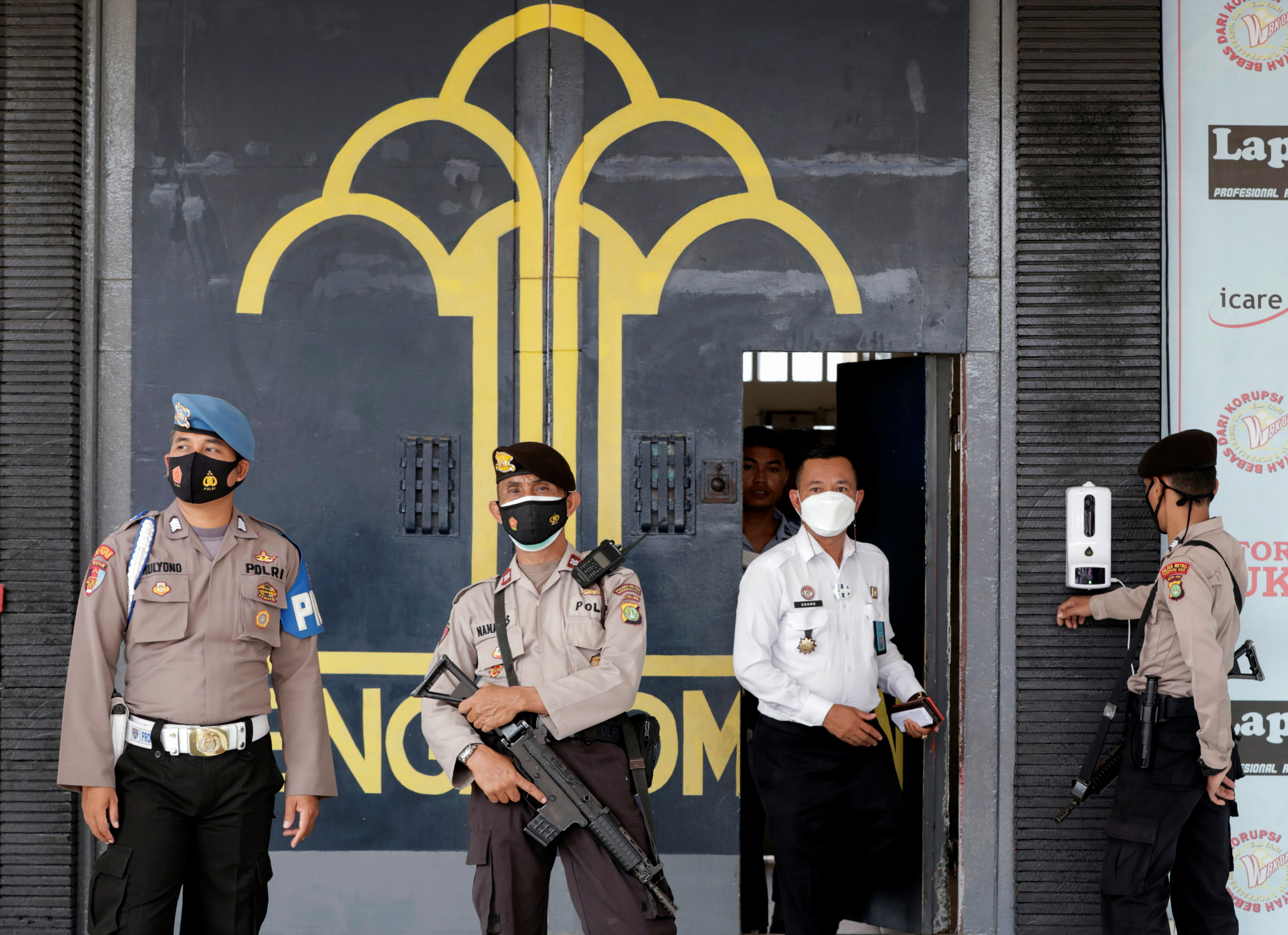 Police officer guards at the main entrance gate of Tangerang prison following a fire overnight at an overcrowded jail in Tangerang on the outskirts of Jakarta, Indonesia, September 8, 2021. REUTERS/Ajeng Dinar Ulfiana