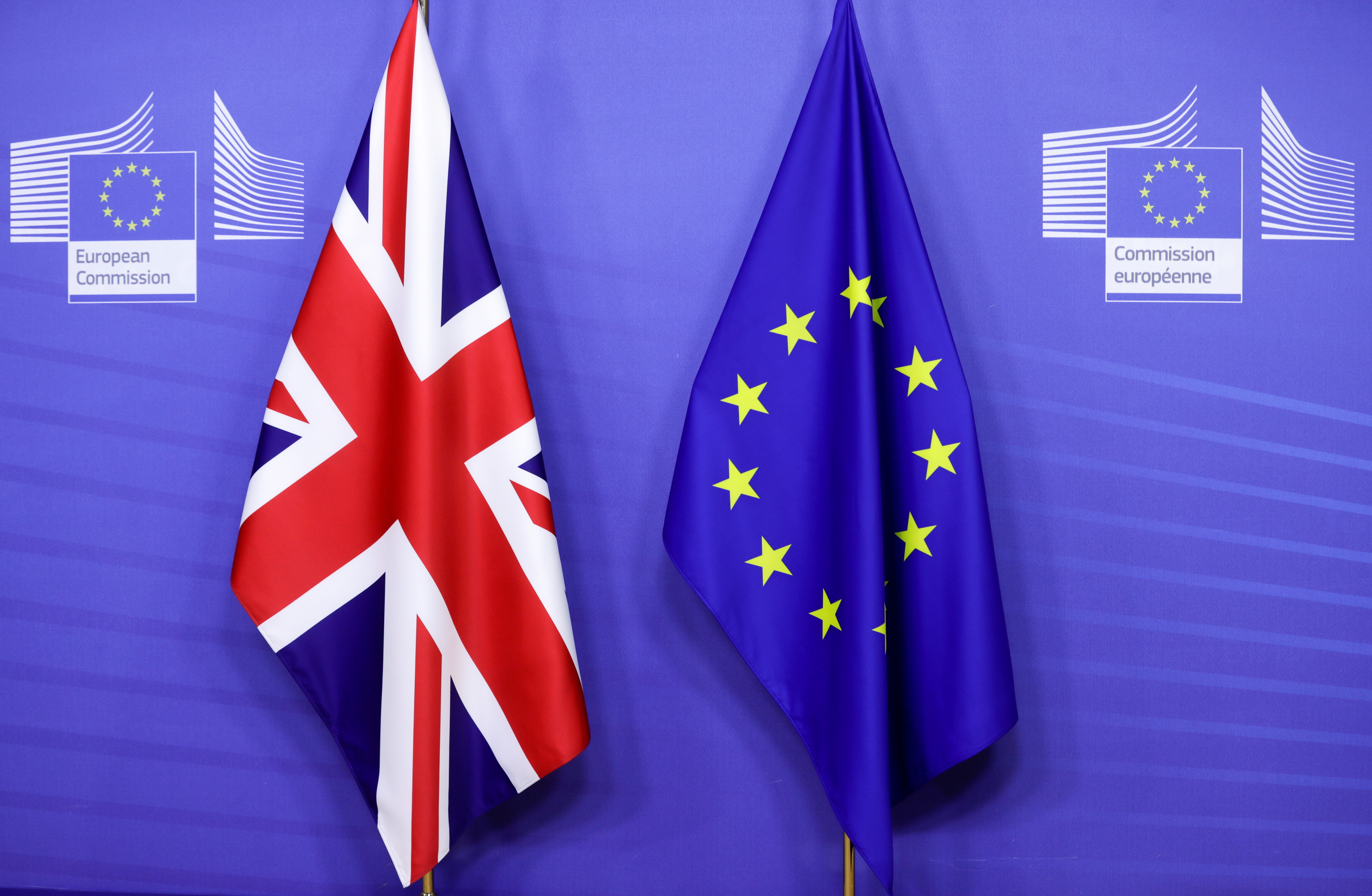Flags of the Union Jack and European Union are seen ahead of the meeting of European Commission President Ursula von der Leyen and British Prime Minister Boris Johnson, in Brussels, Belgium December 9, 2020. Olivier Hoslet/Pool via REUTERS/File Photo