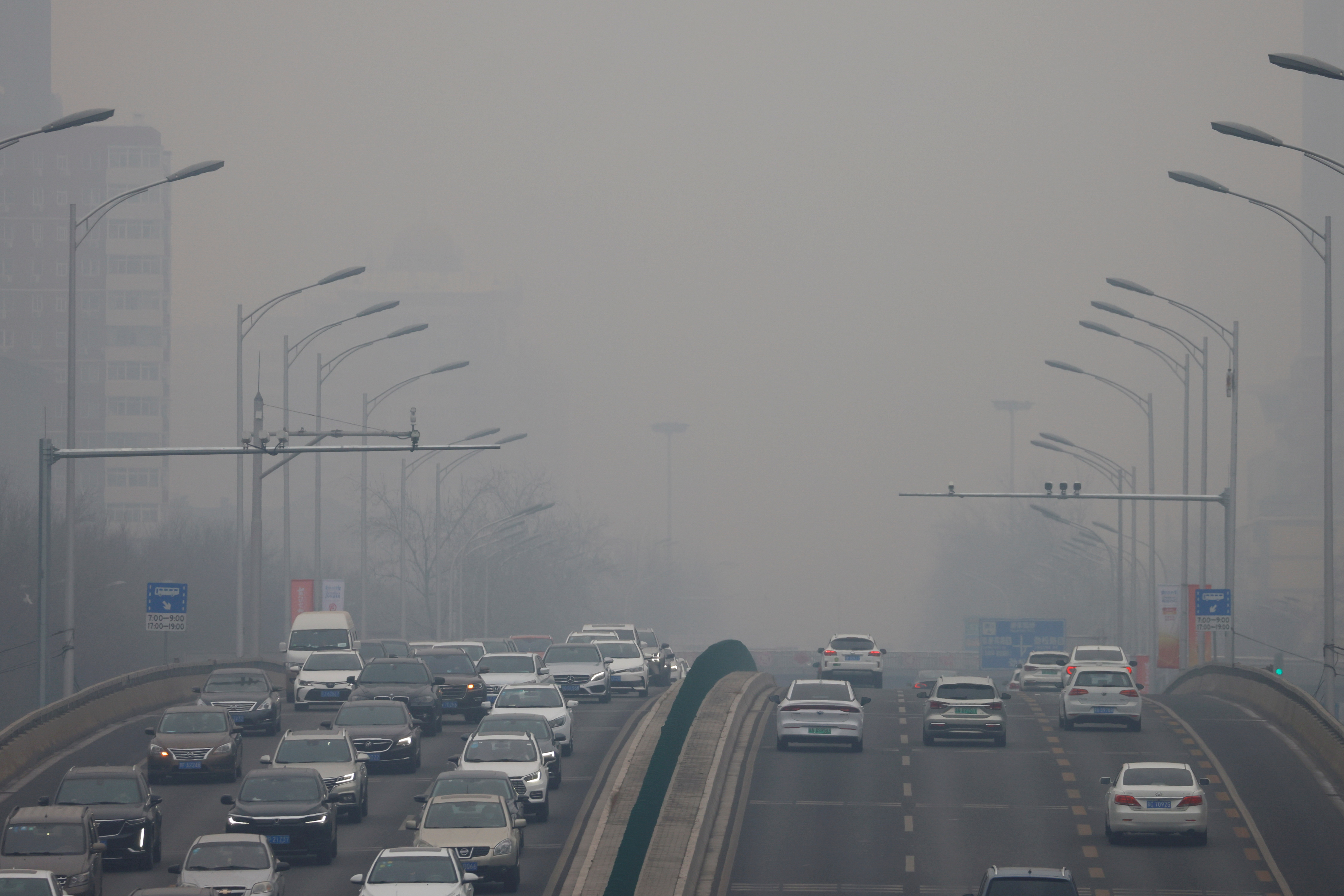 Cars move on a road during a day with polluted air, following the outbreak of the coronavirus disease (COVID-19), in Beijing, China February 13, 2021. REUTERS/Carlos Garcia Rawlins