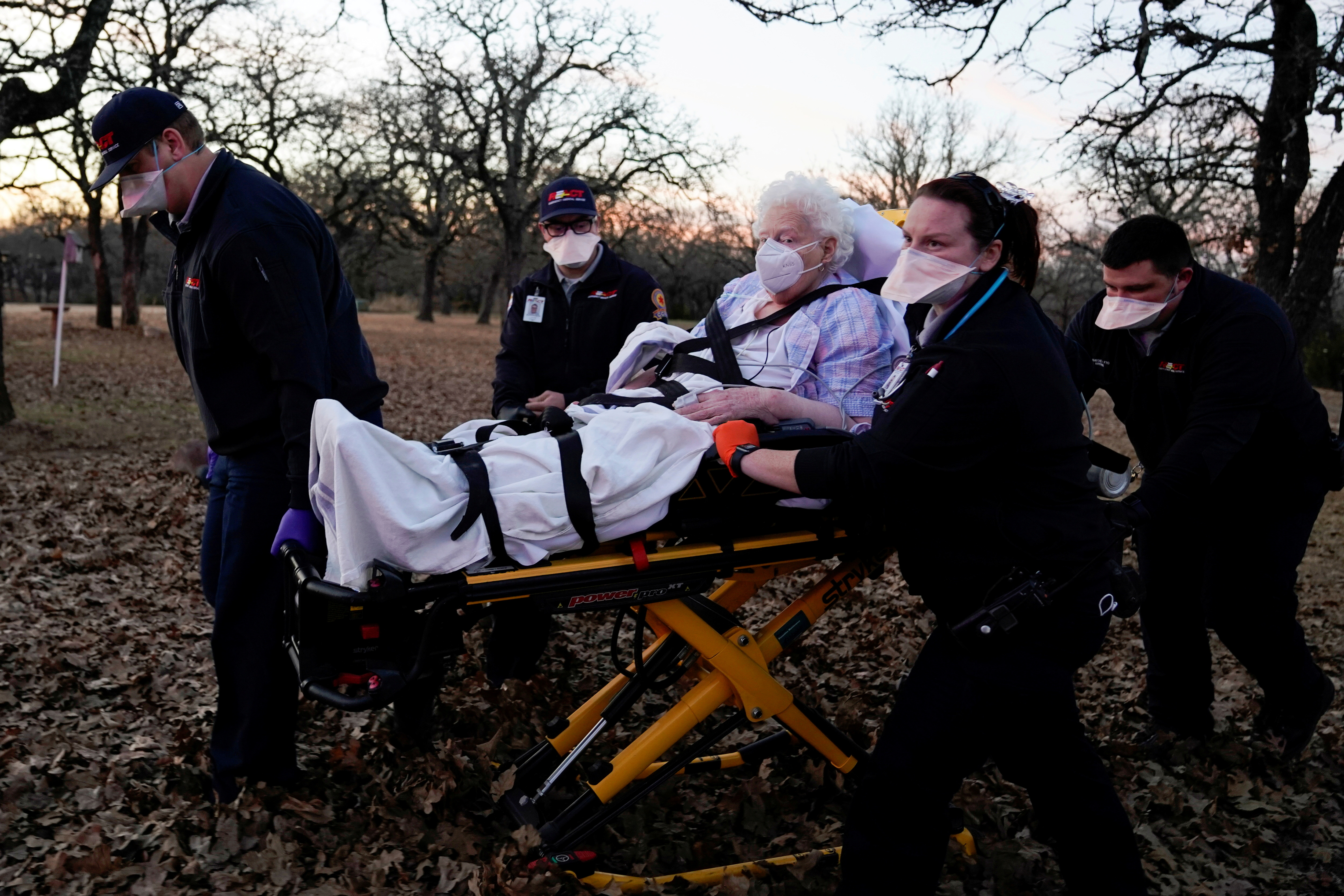 REACT EMS paramedics prepare to transport an 87-yearold woman who had been exposed to the coronavirus disease (COVID-19) and was experiencing symptoms in Meeker, Oklahoma, U.S. December 20, 2020. REUTERS/Nick Oxford