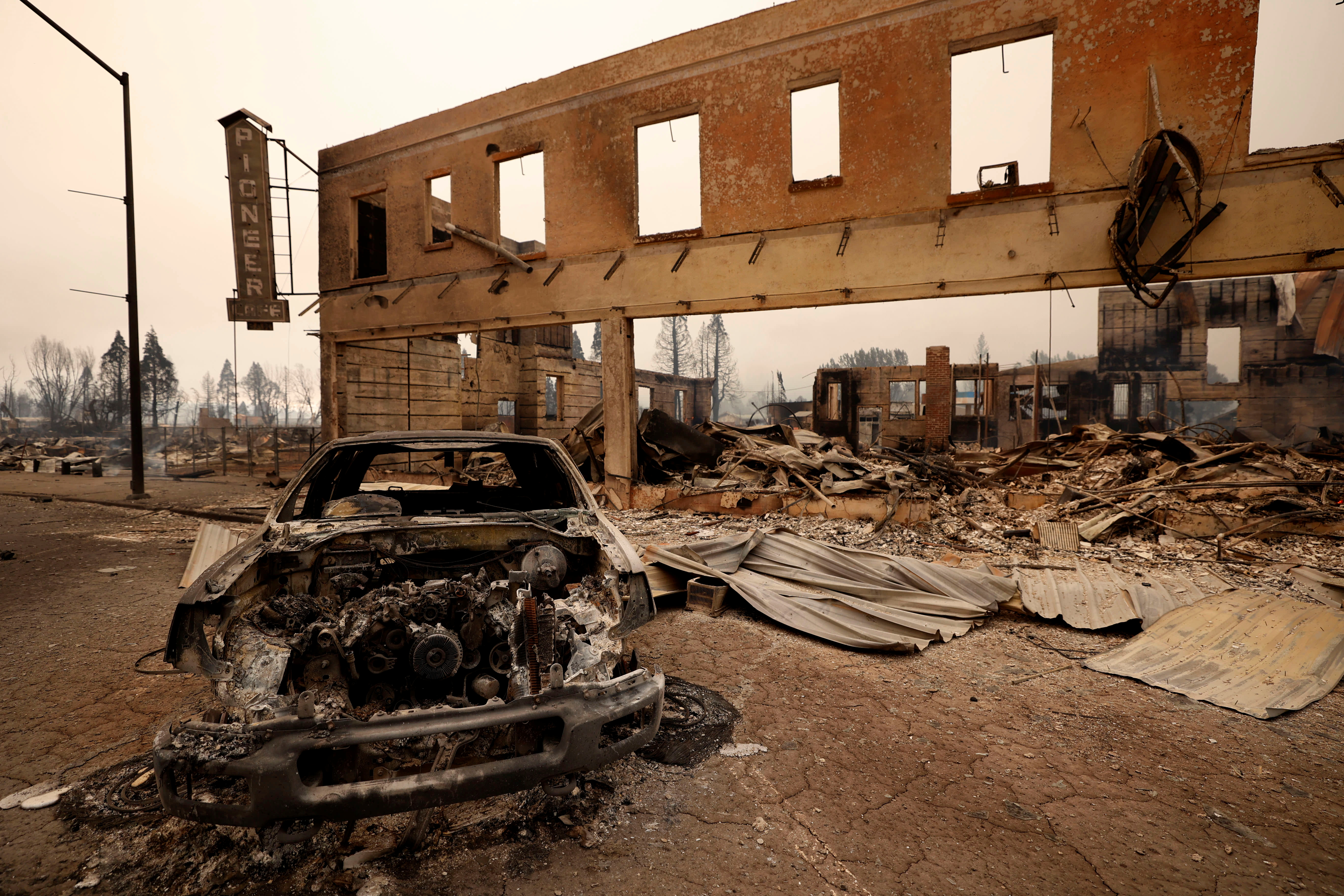 View of a burned out car and commercial building following the Dixie Fire, a wildfire that tore through the town of Greenville, California, U.S. August 5, 2021. REUTERS/Fred Greaves