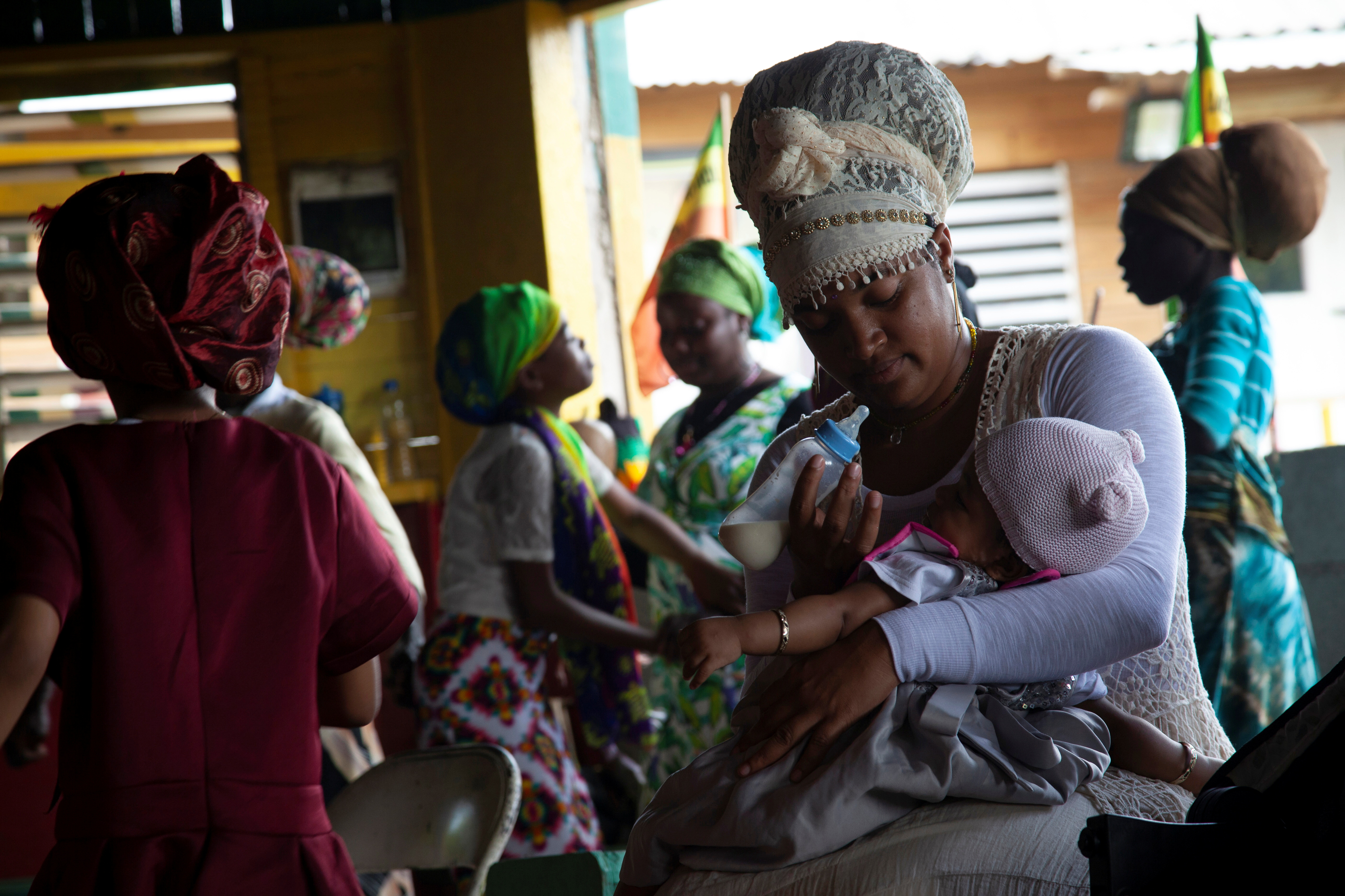 Tasheia Williams feeds her baby after the Sabbath service at the temple of The School of Vision, a Rastafari farming community in the Blue Mountains, near Kingston, Jamaica, on June 19, 2021. REUTERS/Ina Sotirova