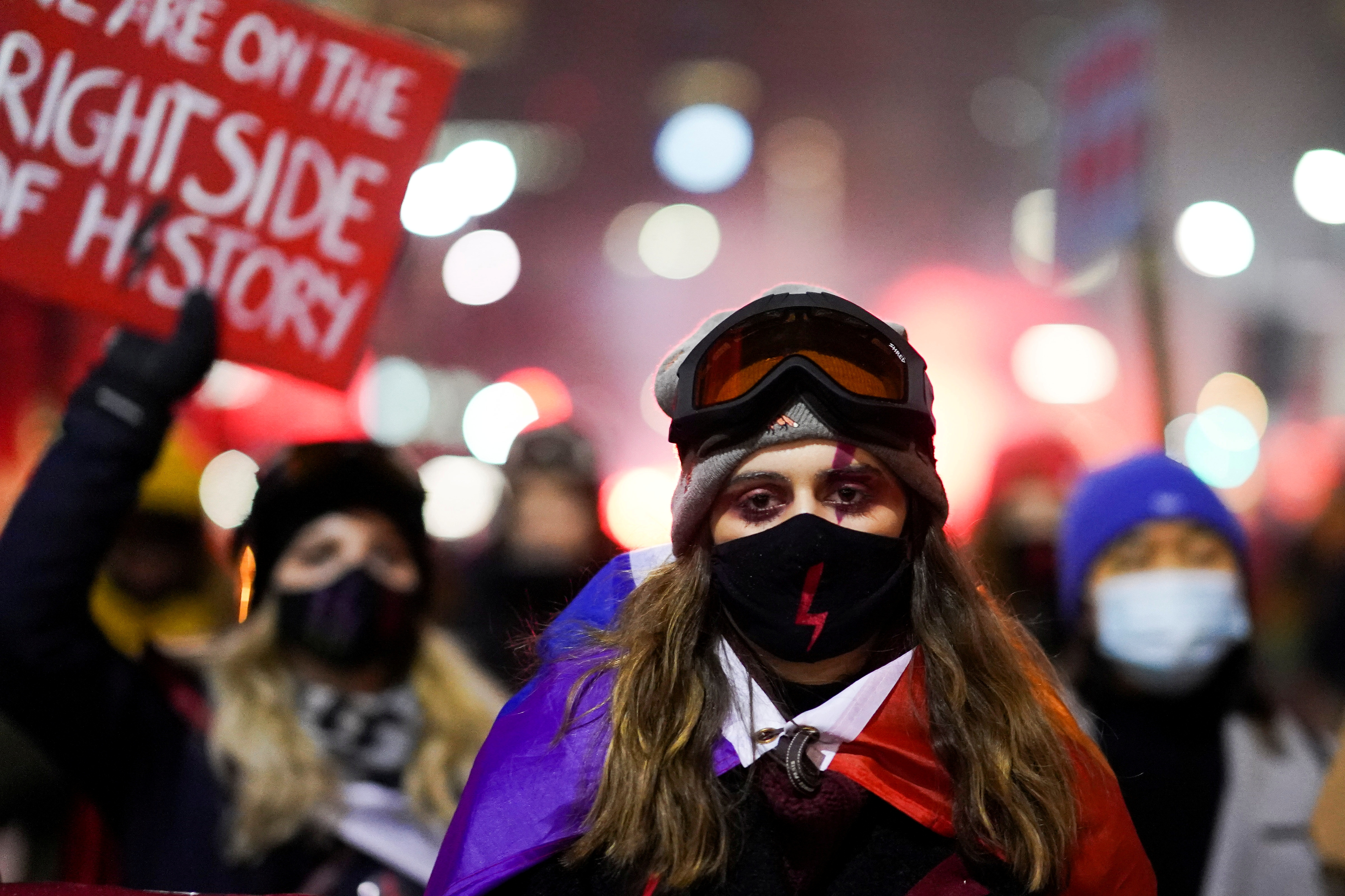 Demonstrators attend a protest against a decision restricting abortion rights in Warsaw, Poland, January 29, 2021. REUTERS/Aleksandra Szmigiel/File Photo