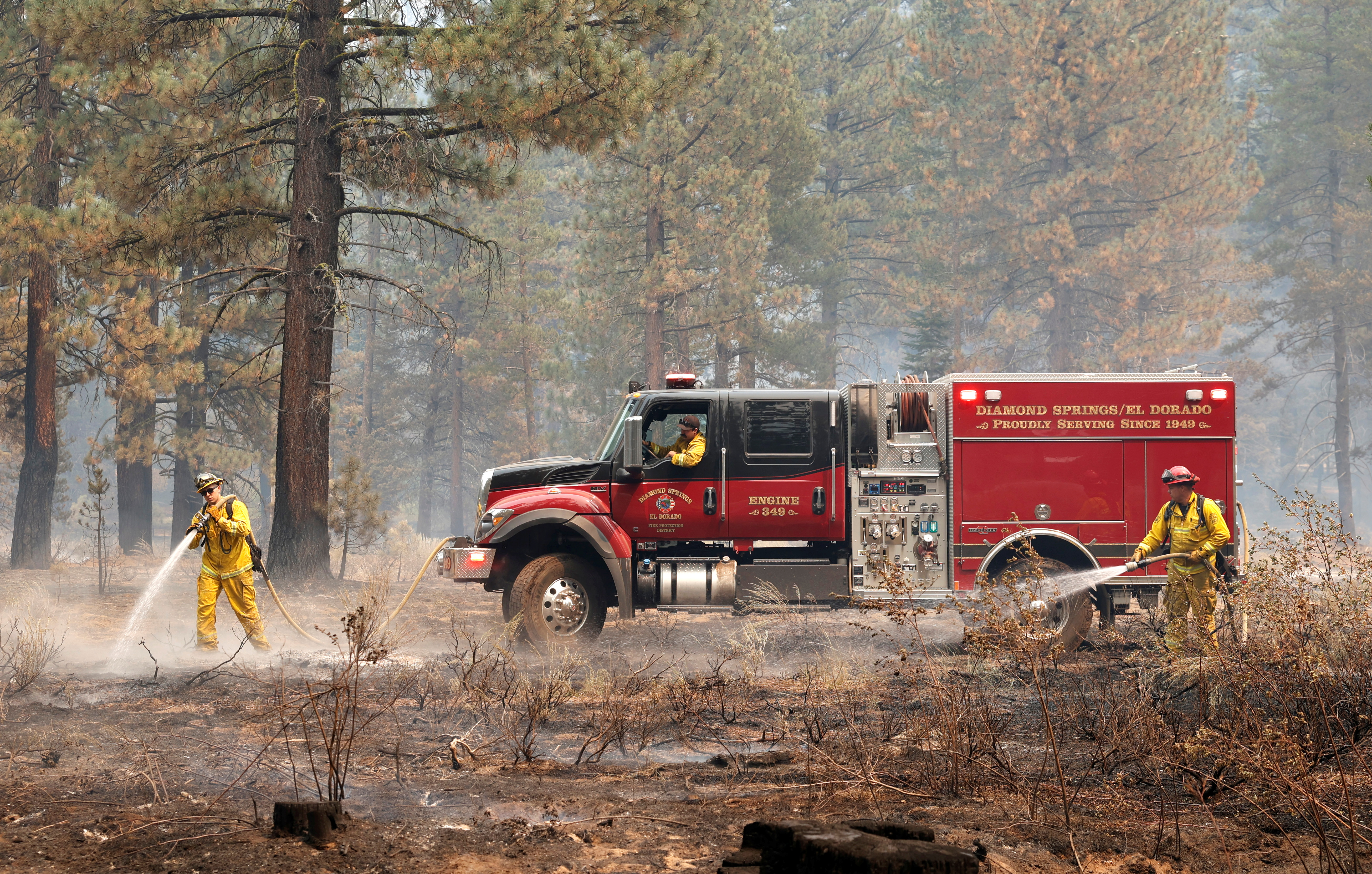 Firefighters knock down hot spots as The Caldor Fire burns near South Lake Tahoe, California, U.S., September 1, 2021. REUTERS/Fred Greaves