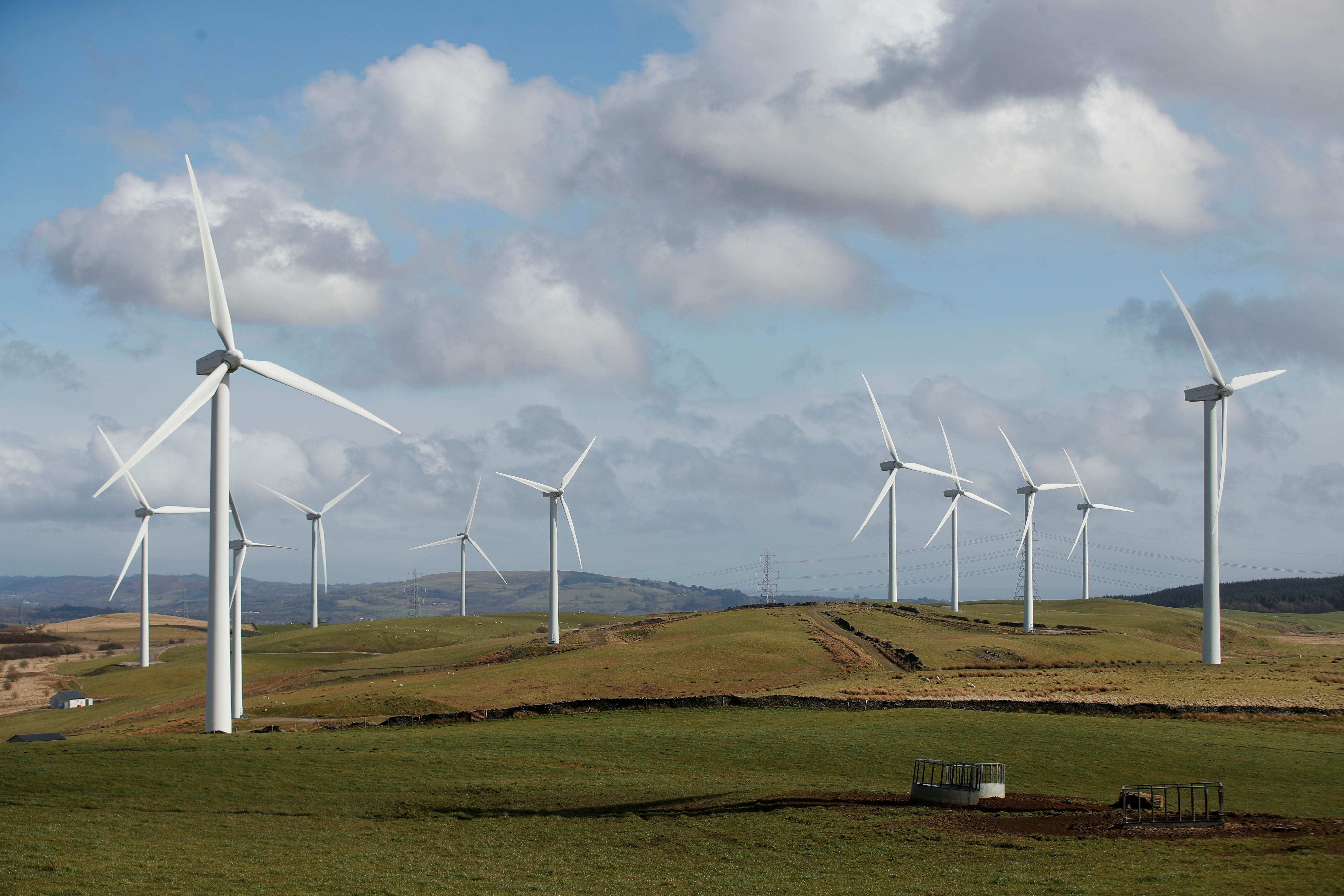 Wind turbines are seen at Mynydd Portref Wind Farm near Hendreforgan in South Wales, Britain, March 26, 2021. REUTERS/Matthew Childs