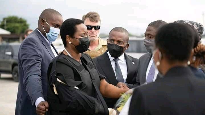 Haiti's first lady Martine Moise (L), the wife of assassinated President Jovenel Moise, is greeted by Haiti's interim Prime Minister Claude Jospeh, after arriving from the U.S, in Port-au-Prince, Haiti, in this undated photograph obtained by Reuters on July 17, 2021. Prime Minister's Office/Handout via REUTERS