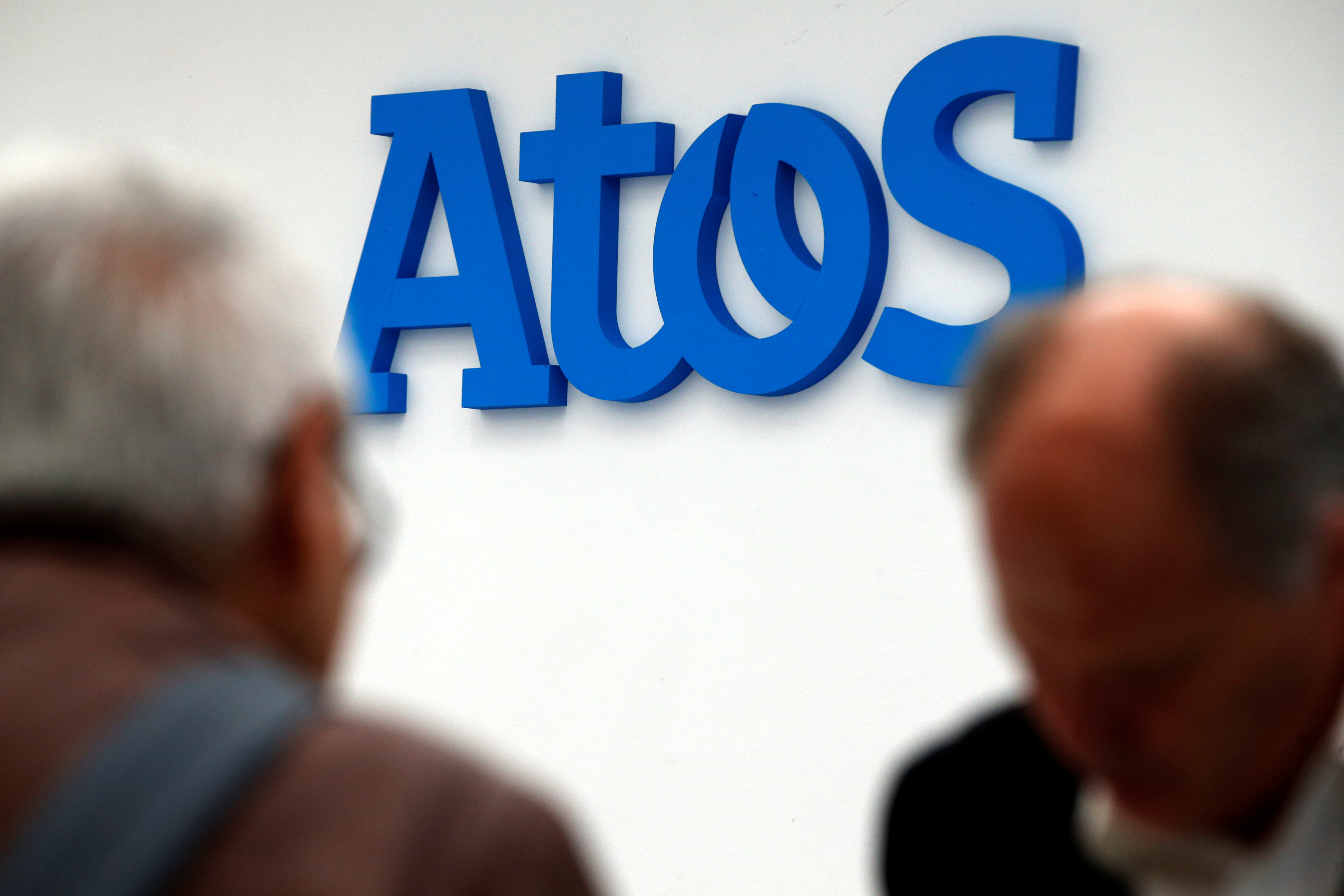 People walk in front of the Atos company's logo in Paris, France, April 12, 2016. REUTERS/Philippe Wojazer