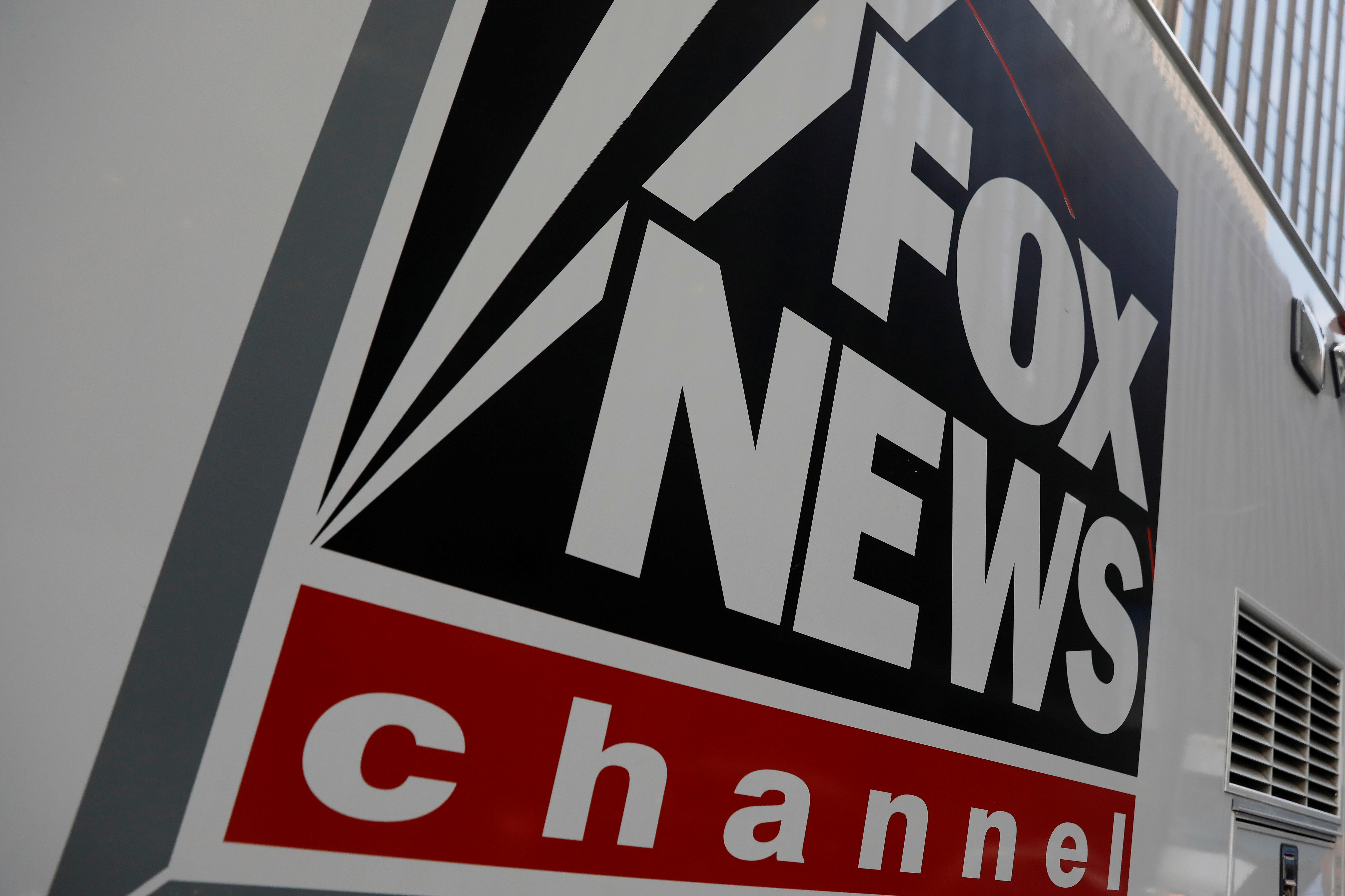 A Fox News channel sign is seen on a television vehicle outside the News Corporation building in New York City. November 8, 2017. REUTERS/Shannon Stapleton