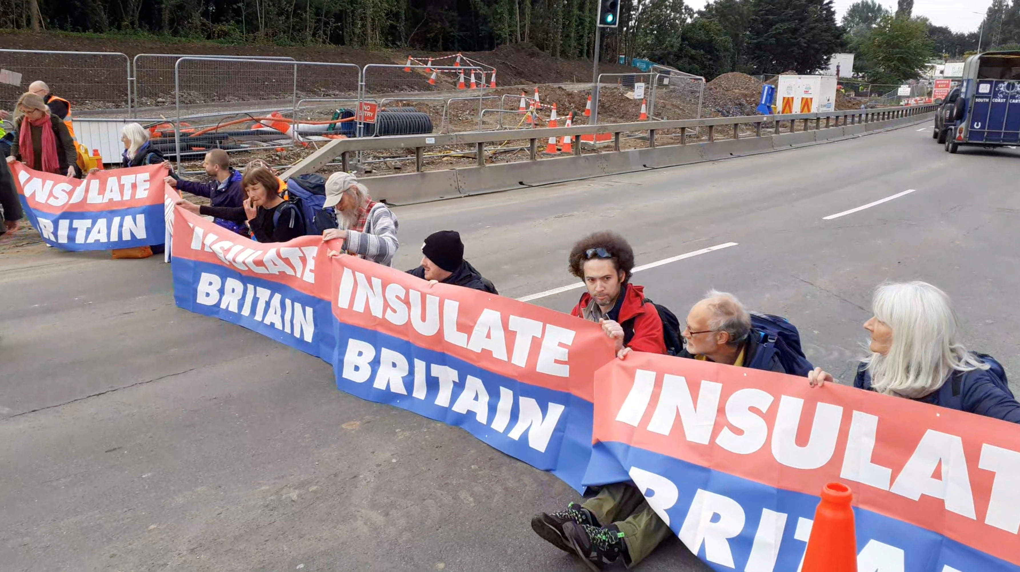 Members of Insulate Britain protest on M25 Motorway, Britain September 15, 2021, in this still image taken from a handout video. Insulate Britain/Handout via REUTERS