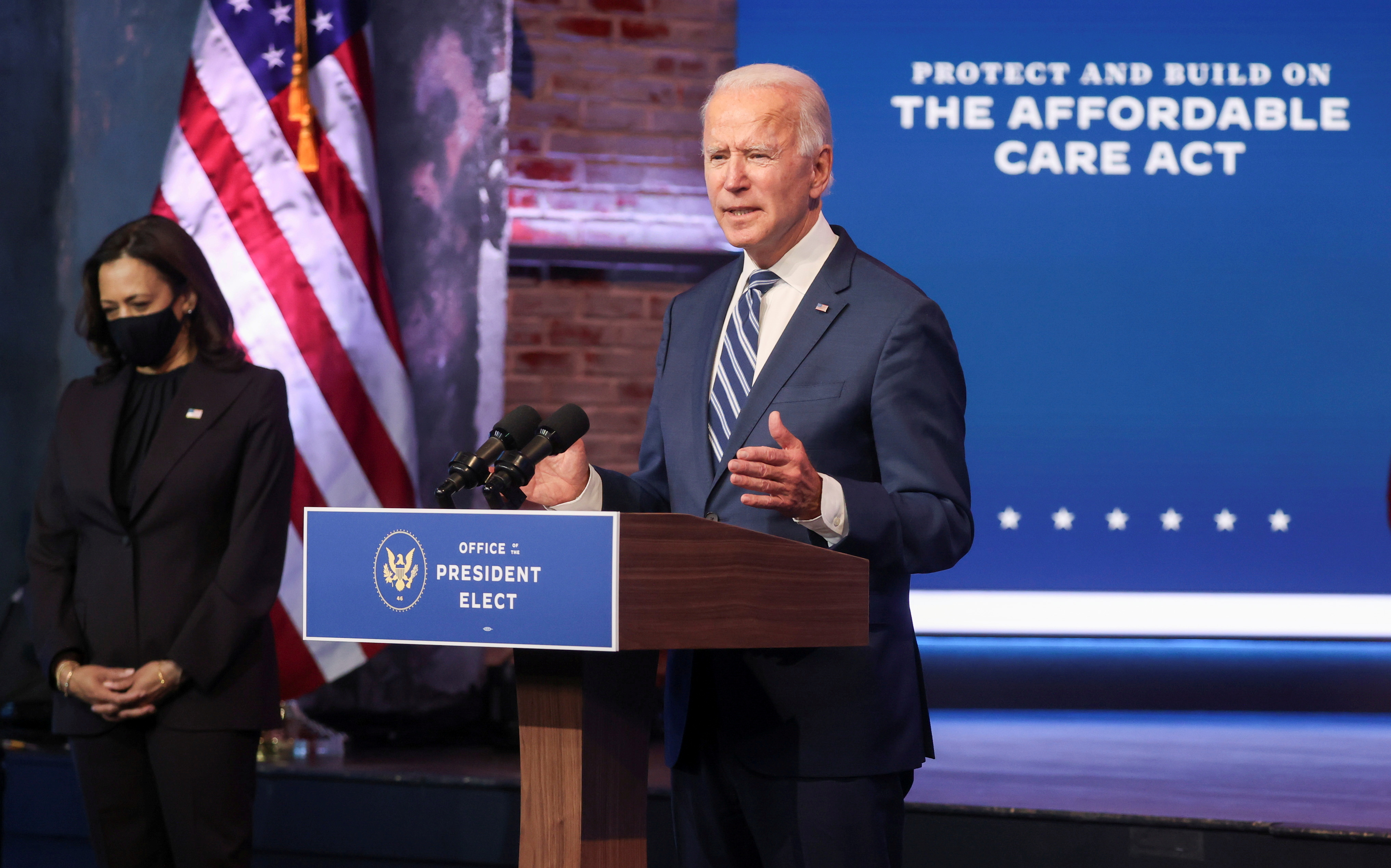 U.S. President-elect Joe Biden talks about protecting the Affordable Care Act (ACA) as he speaks to reporters with Vice President-elect Kamala Harris at this side about their