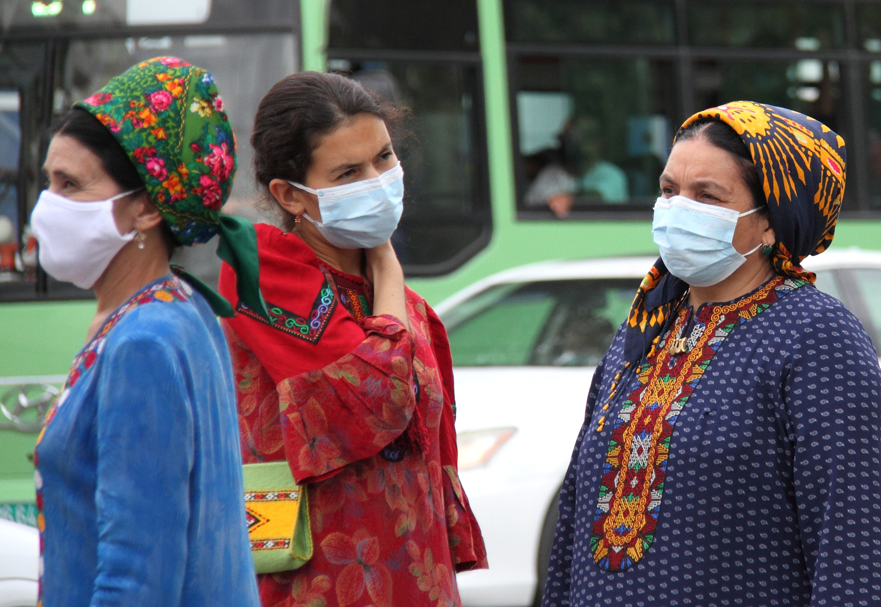 Women wearing protective face masks, used as a preventive measure against the spread of the coronavirus disease (COVID-19), are seen at a bus stop in Ashgabat, Turkmenistan July 13, 2020. Picture taken July 13, 2020. REUTERS/Vyacheslav Sarkisyan