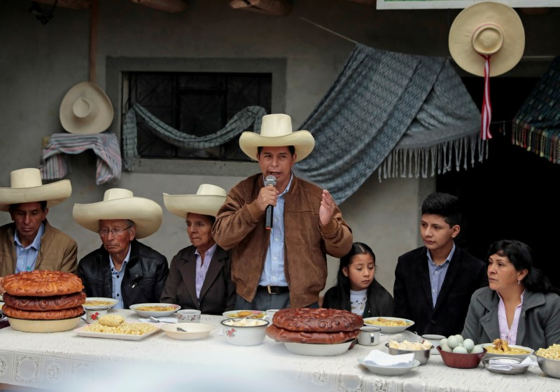 Peru's presidential candidate Pedro Castillo addresses the media during a breakfast with members of his family before casting his vote, in Chugur, Peru June 6, 2021.  REUTERS/Alessandro Cinque/File Photo