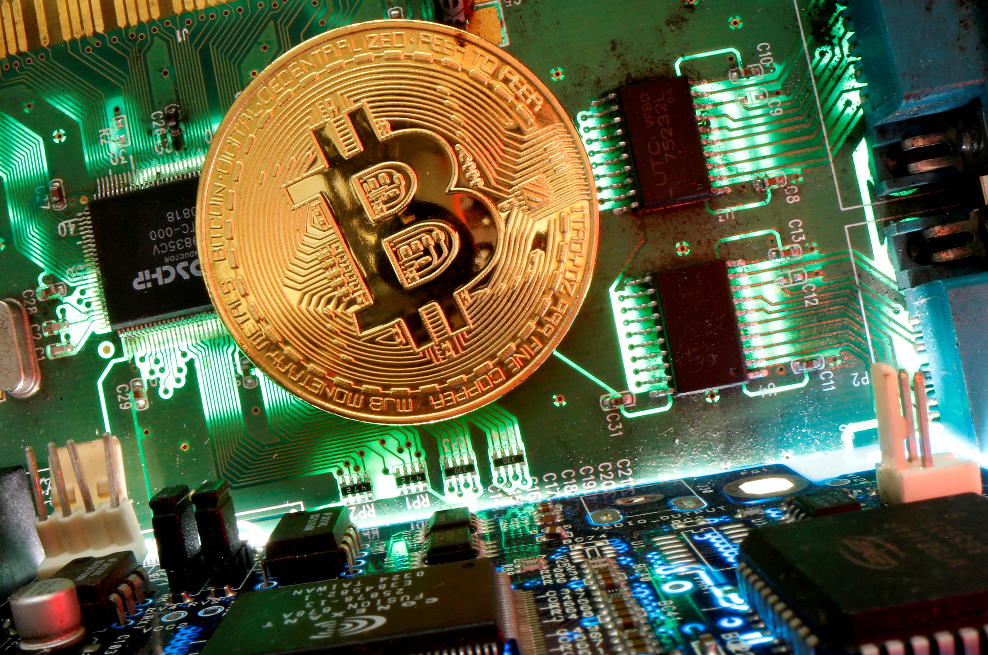Representation of the virtual currency Bitcoin is seen on a motherboard in this picture illustration taken April 24, 2020. REUTERS/Dado Ruvic/Illustration/File Photo/File Photo