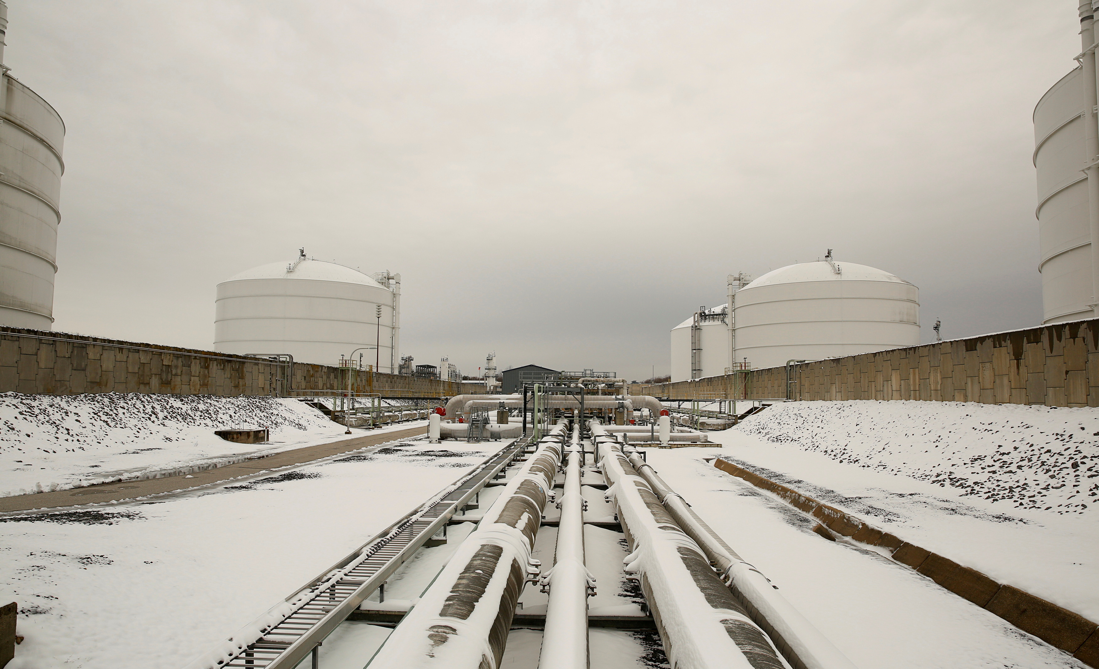 Snow covered transfer lines leading to storage tanks at the Dominion Cove Point Liquefied Natural Gas (LNG) terminal in Lusby, Maryland, March 18, 2014. REUTERS/Gary Cameron