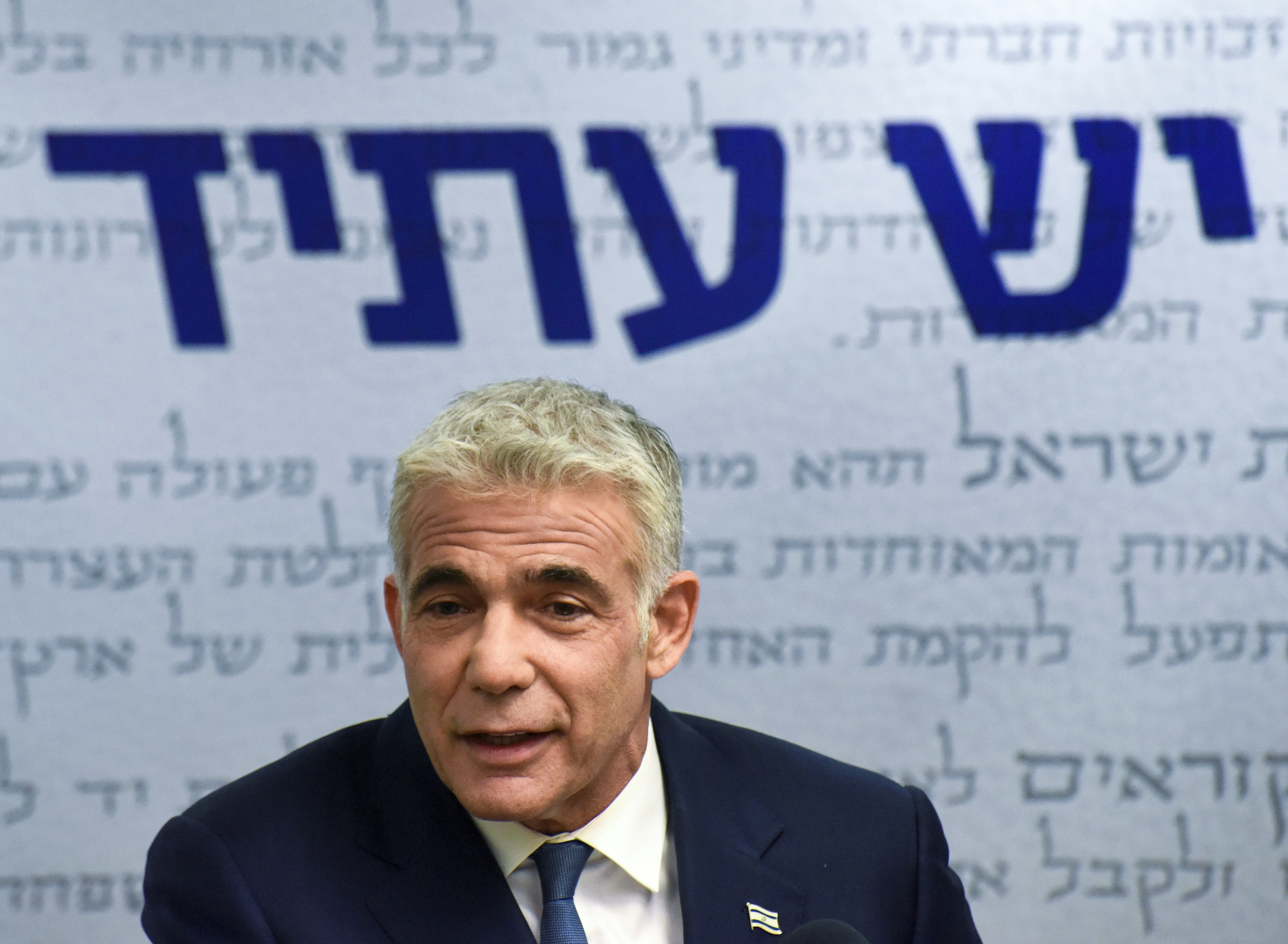Yair Lapid, head of the centrist Yesh Atid party, delivers a statement to the press before the party faction meeting at the Knesset, Israel's parliament, in Jerusalem May 31, 2021. Debbie Hill/Pool via REUTERS