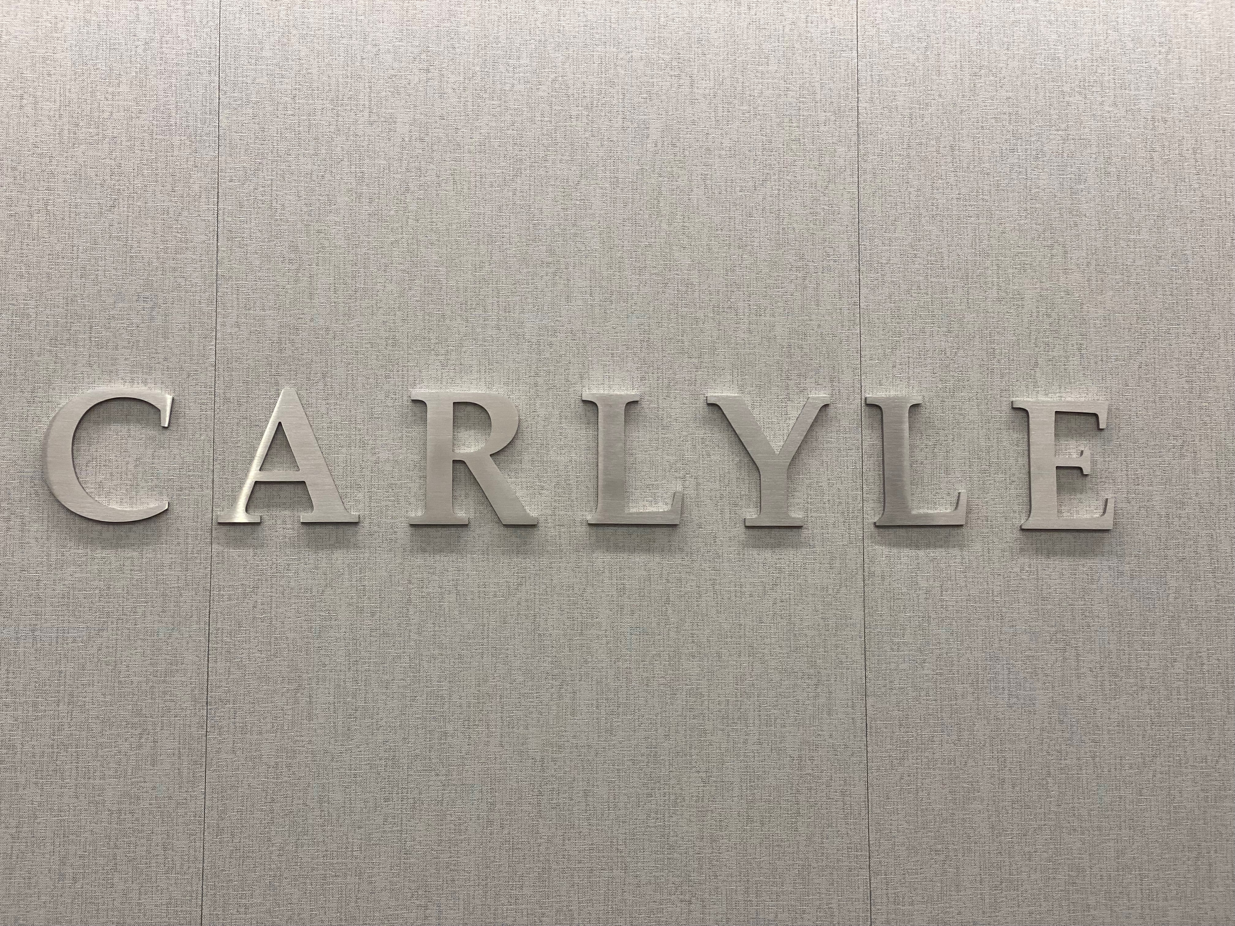 A Carlyle group logo is pictured at One Vanderbilt , New York, U.S., September 15, 2021. Picture taken September 15, 2021.   Carlyle Group/Handout via REUTERS
