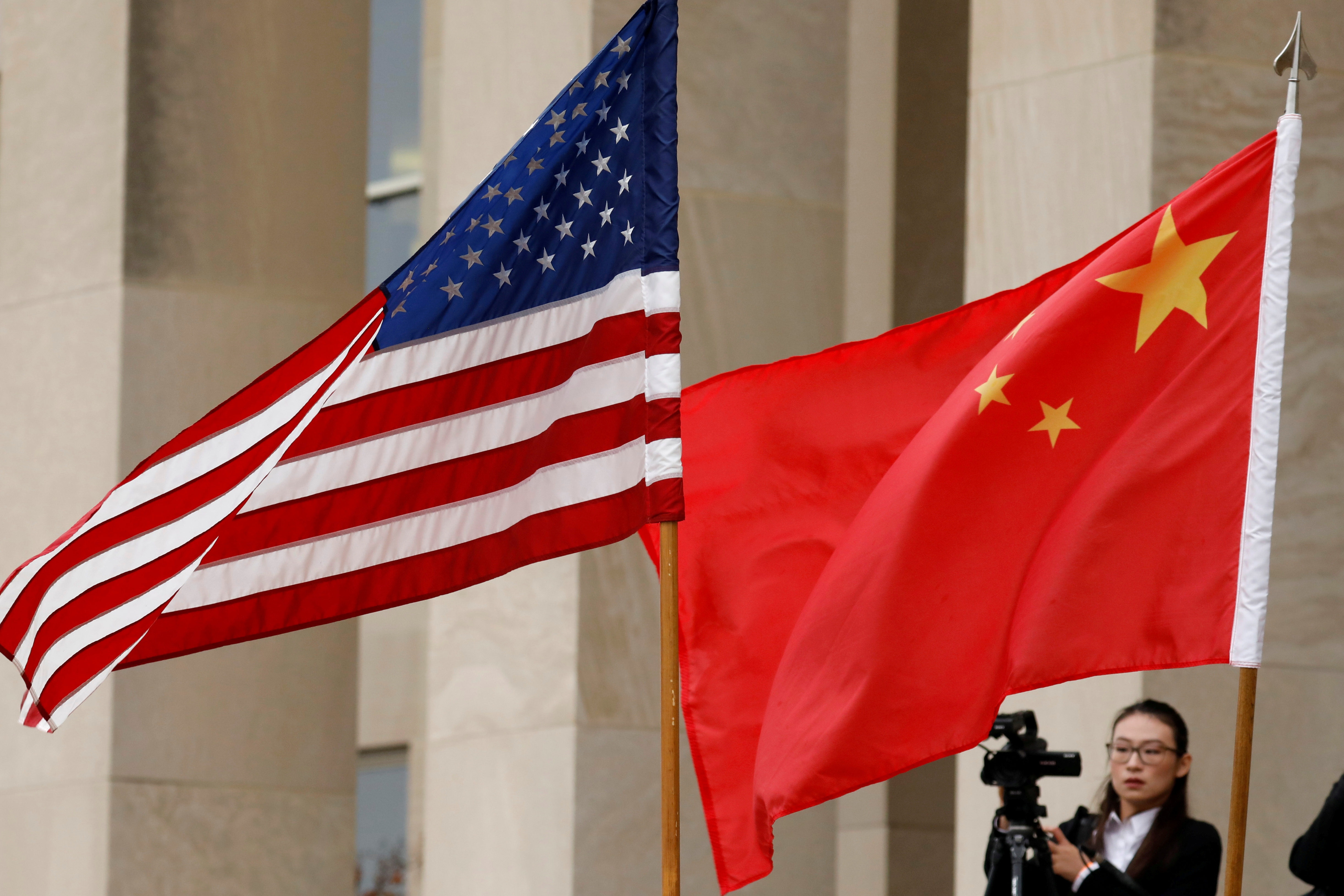 U.S. and Chinese flags are seen before a meeting between senior defence officials from both countries at the Pentagon in Arlington, Virginia, U.S., November 9, 2018. REUTERS/Yuri Gripas