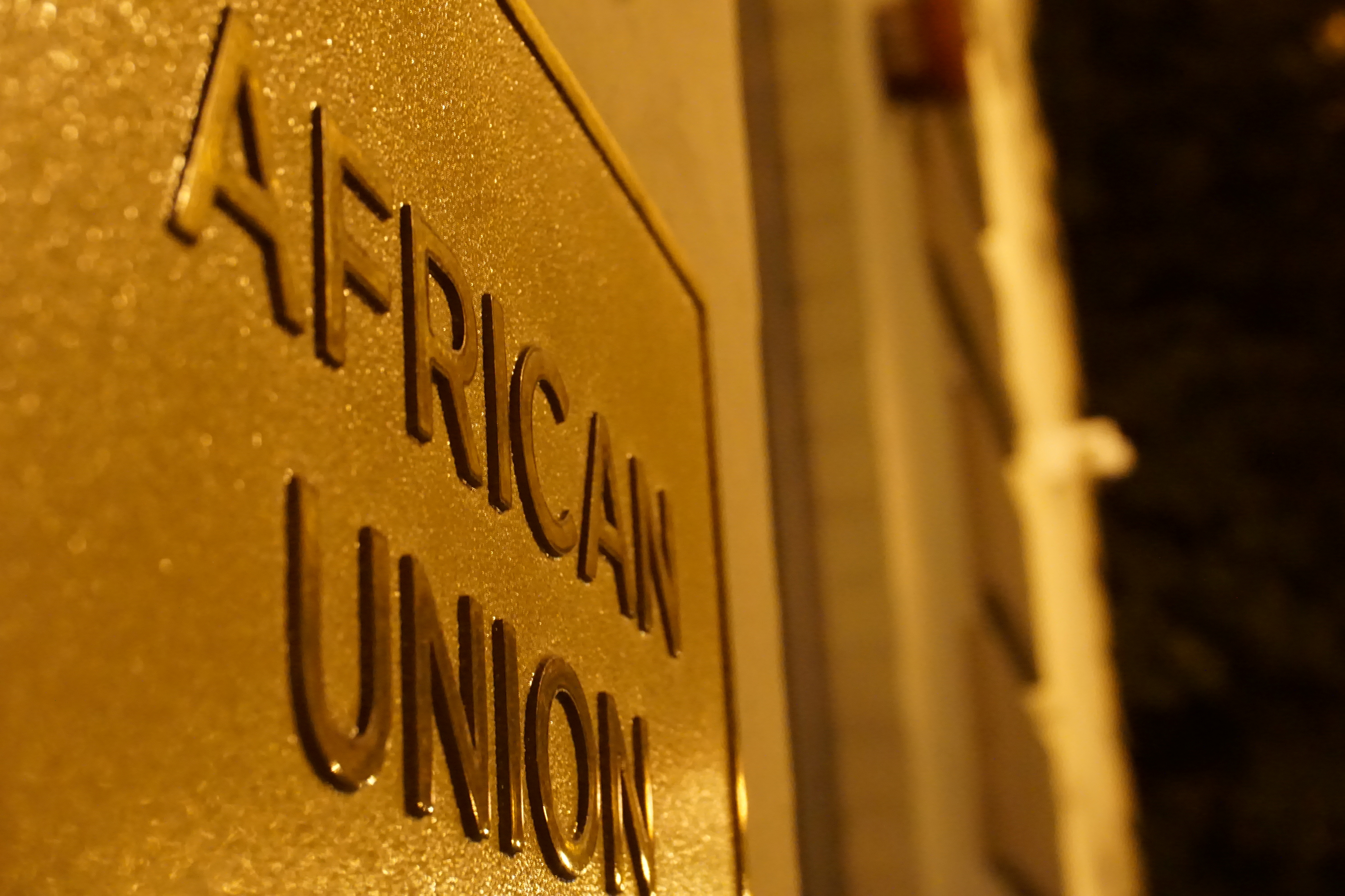 A signage at an entrance to the African Union (AU) Mission is pictured in Washington, D.C., U.S. December 15, 2020. Picture taken with a long exposure.  REUTERS/Raphael Satter