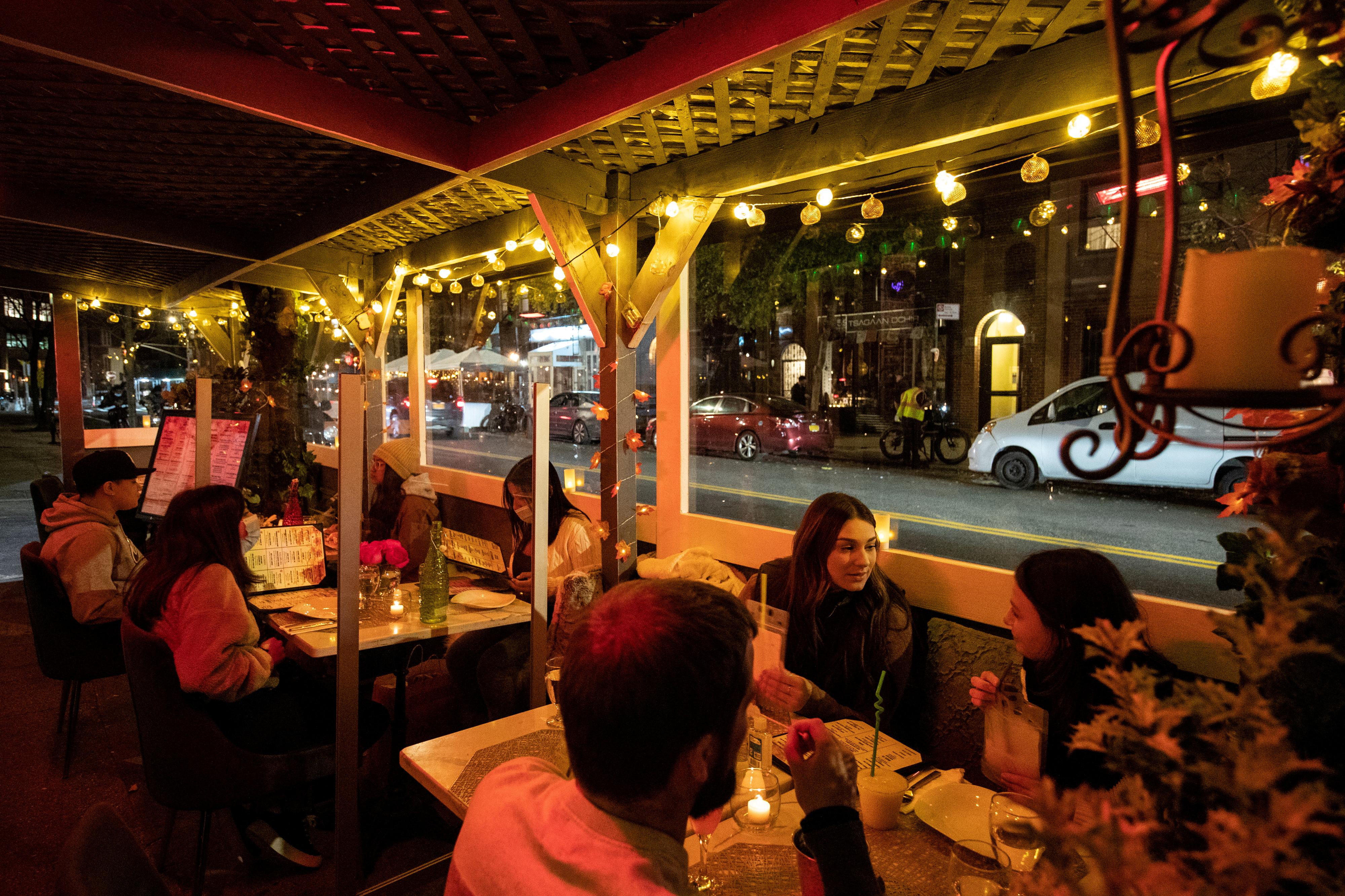 People enjoy outdoor dining at the Sveta restaurant as the spread of the coronavirus disease (COVID-19) continues, in New York City, New York, U.S., November 21, 2020. REUTERS/Jeenah Moon/File Photo