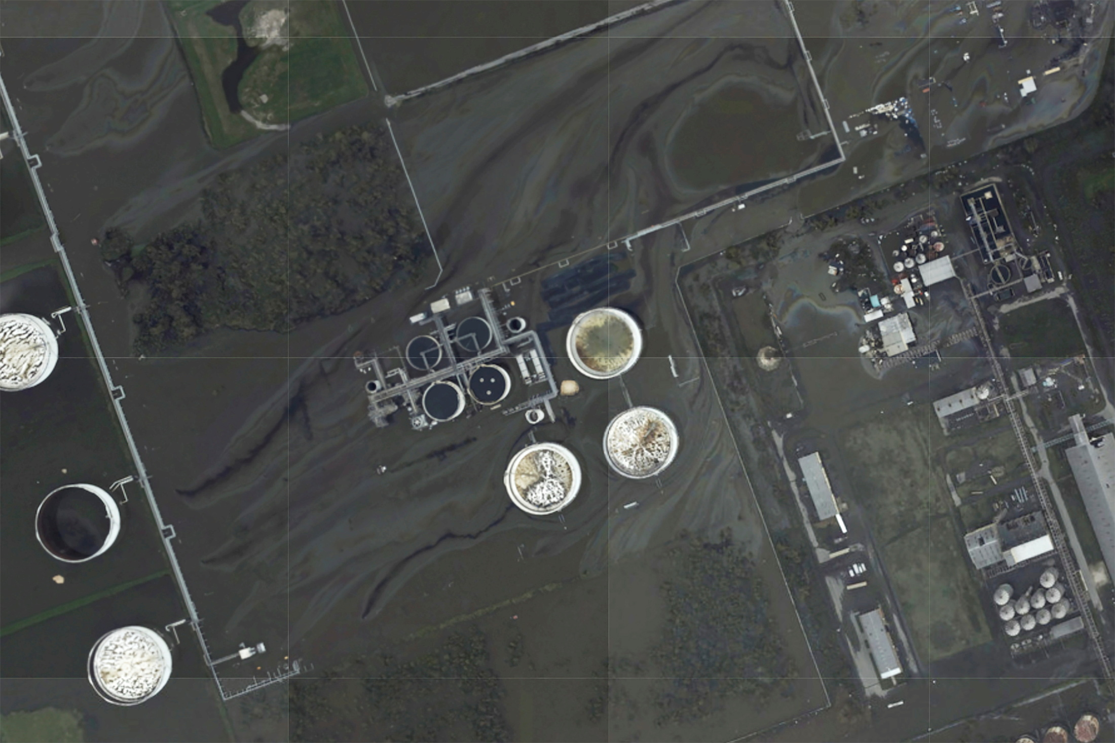 A sheen appears on the flooded property of the Phillips 66 Alliance Refinery, following the passing of Hurricane Ida in an NOAA surveillance photograph taken south of Belle Chasse, Louisiana, U.S. August 31, 2021. NOAA/Handout via REUTERS