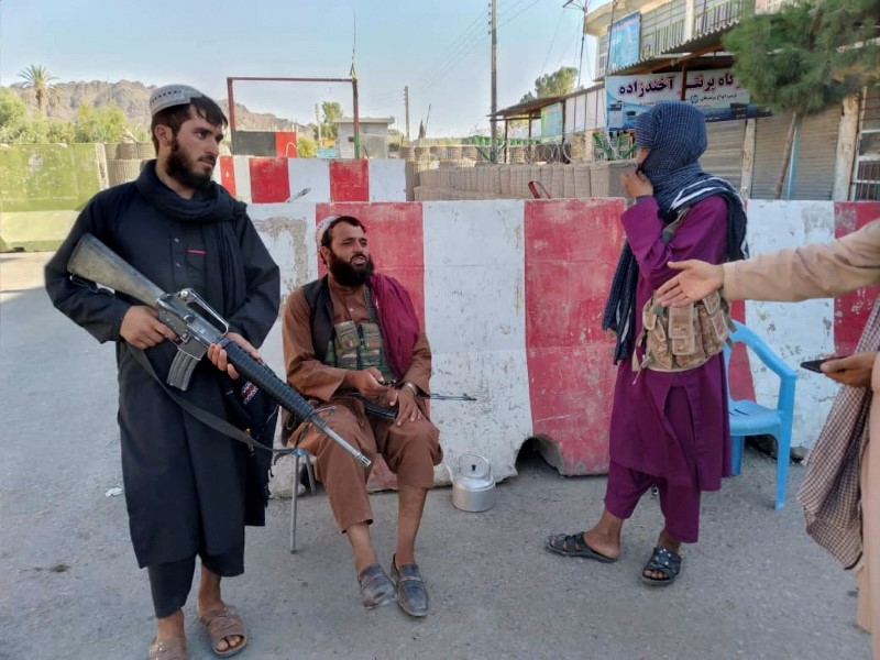Taliban fighters stand guard at a check point in Farah, Afghanistan August 11, 2021. REUTERS/Stringer