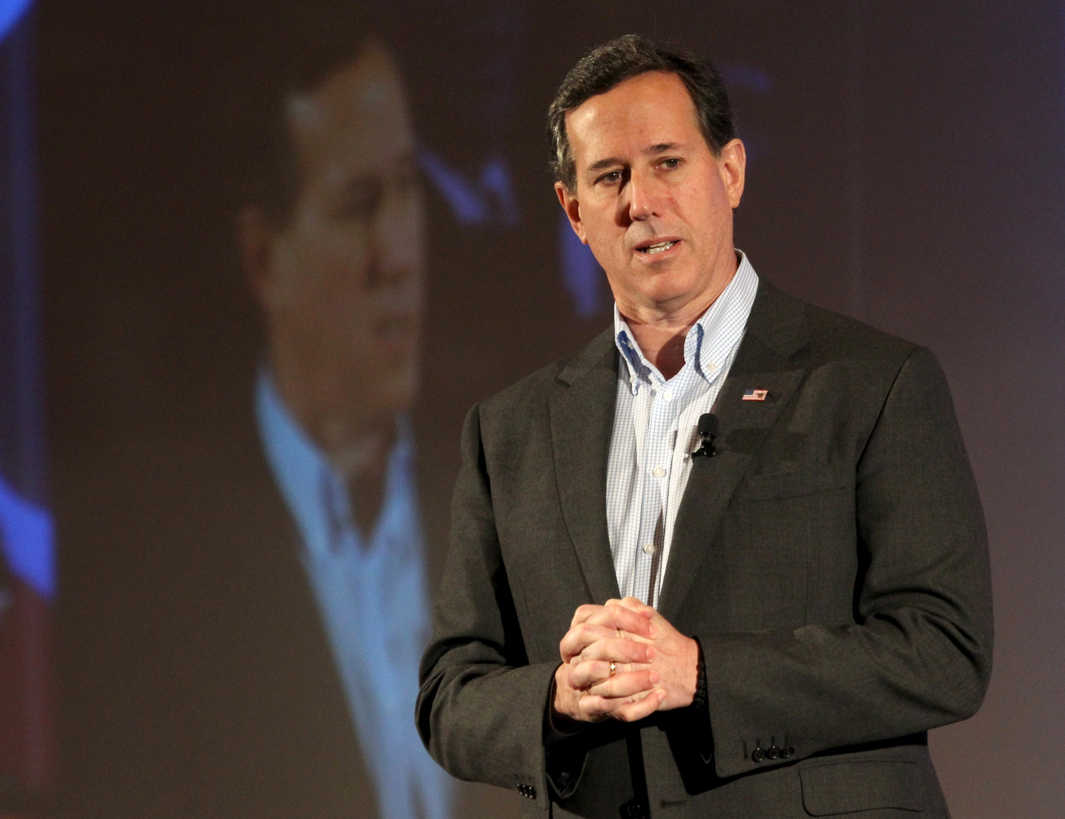 U.S. Republican presidential candidate Rick Santorum speaks at the New Hampshire GOP's FITN Presidential town hall in Nashua, New Hampshire January 23, 2016.     REUTERS/Mary Schwalm