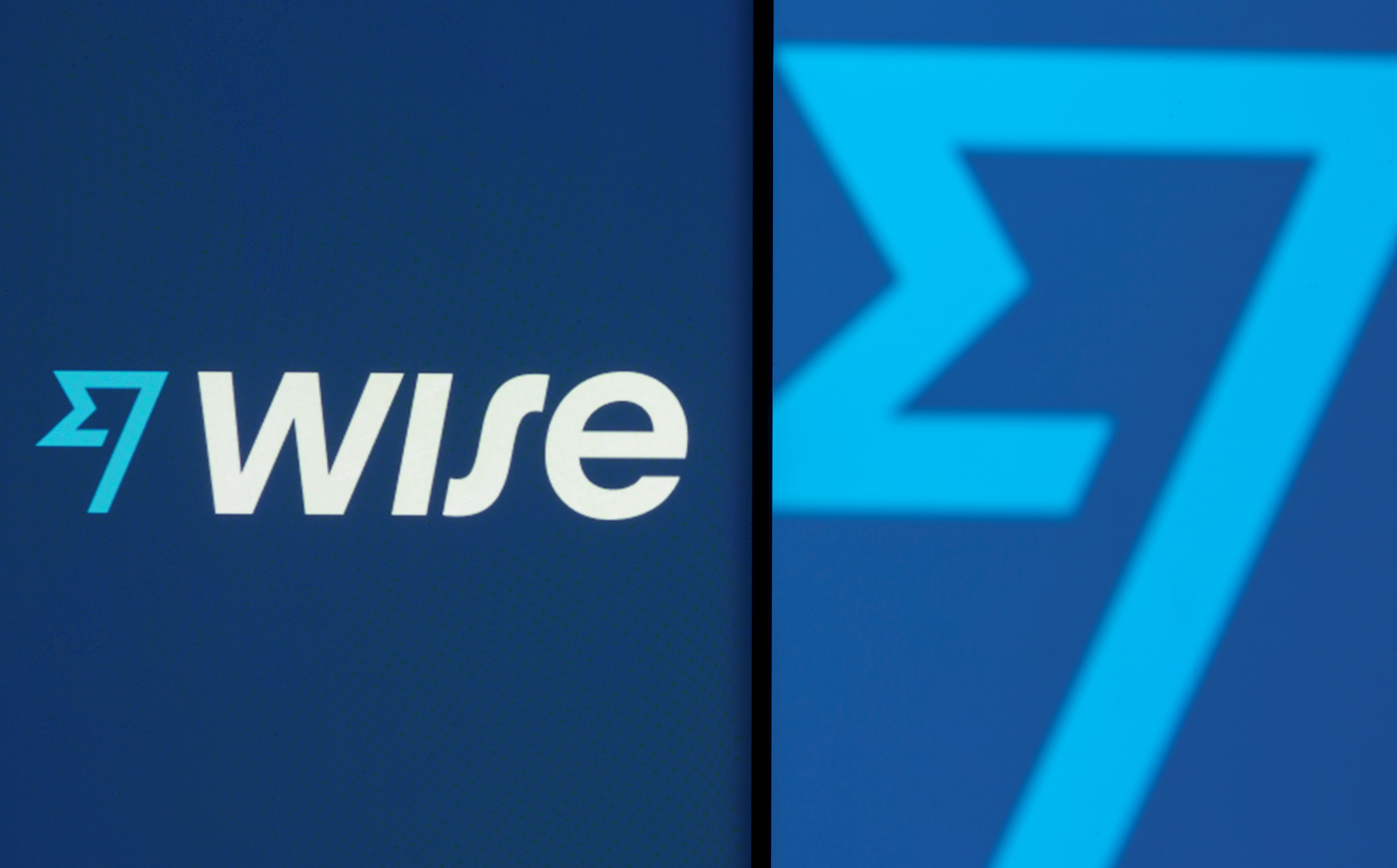 Wise logo is seen on a smartphone in front of a displayed detail of the same logo in this illustration taken June 18, 2021. REUTERS/Dado Ruvic/Illustration/File Photo