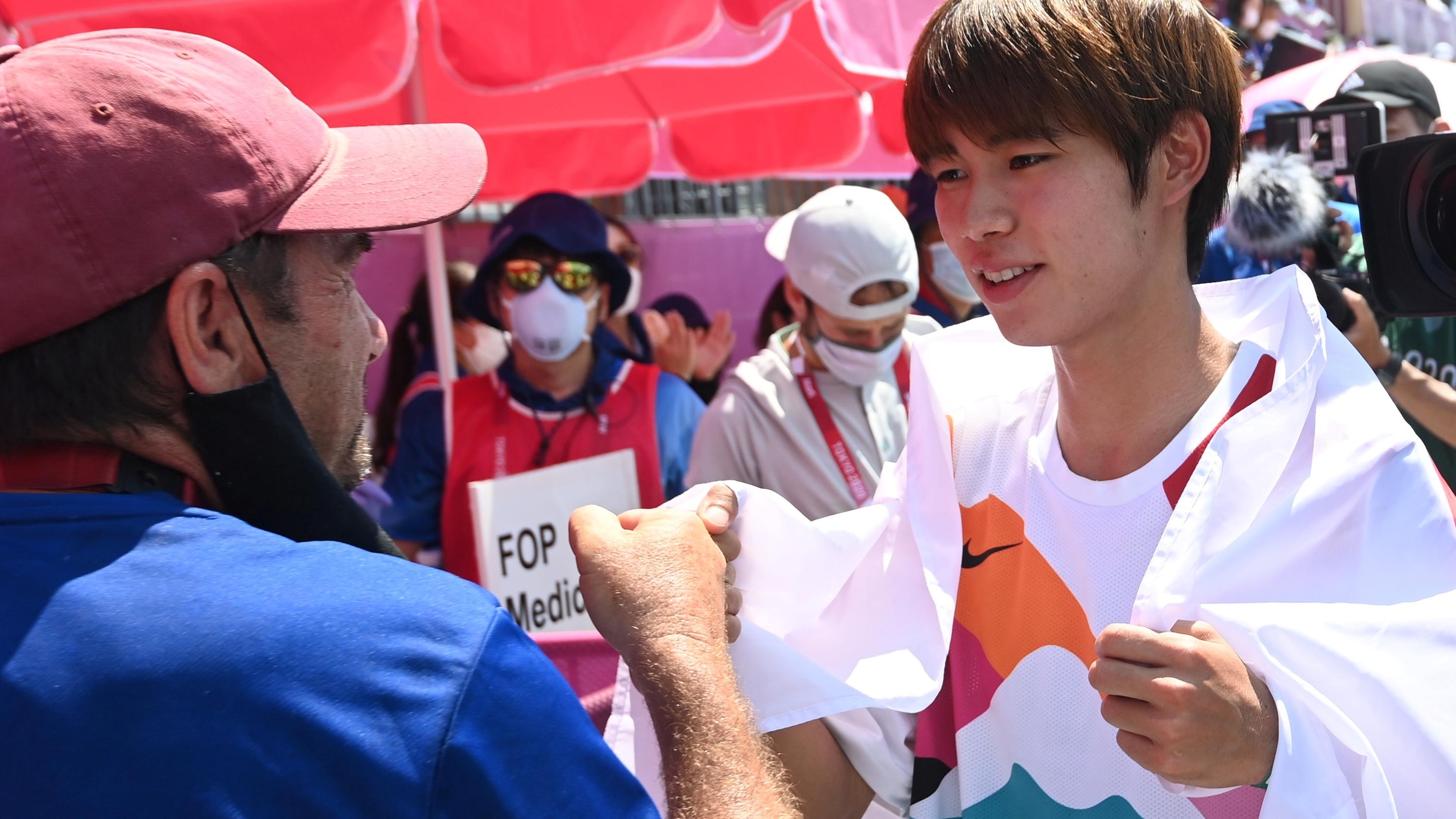 Tokyo 2020 Olympics - Skateboarding - Men's Street - Final - Ariake Urban Sports Park - Tokyo, Japan - July 25, 2021. Yuto Horigome of Japan wears national flag as he celebrates victory. REUTERS/Toby Melville