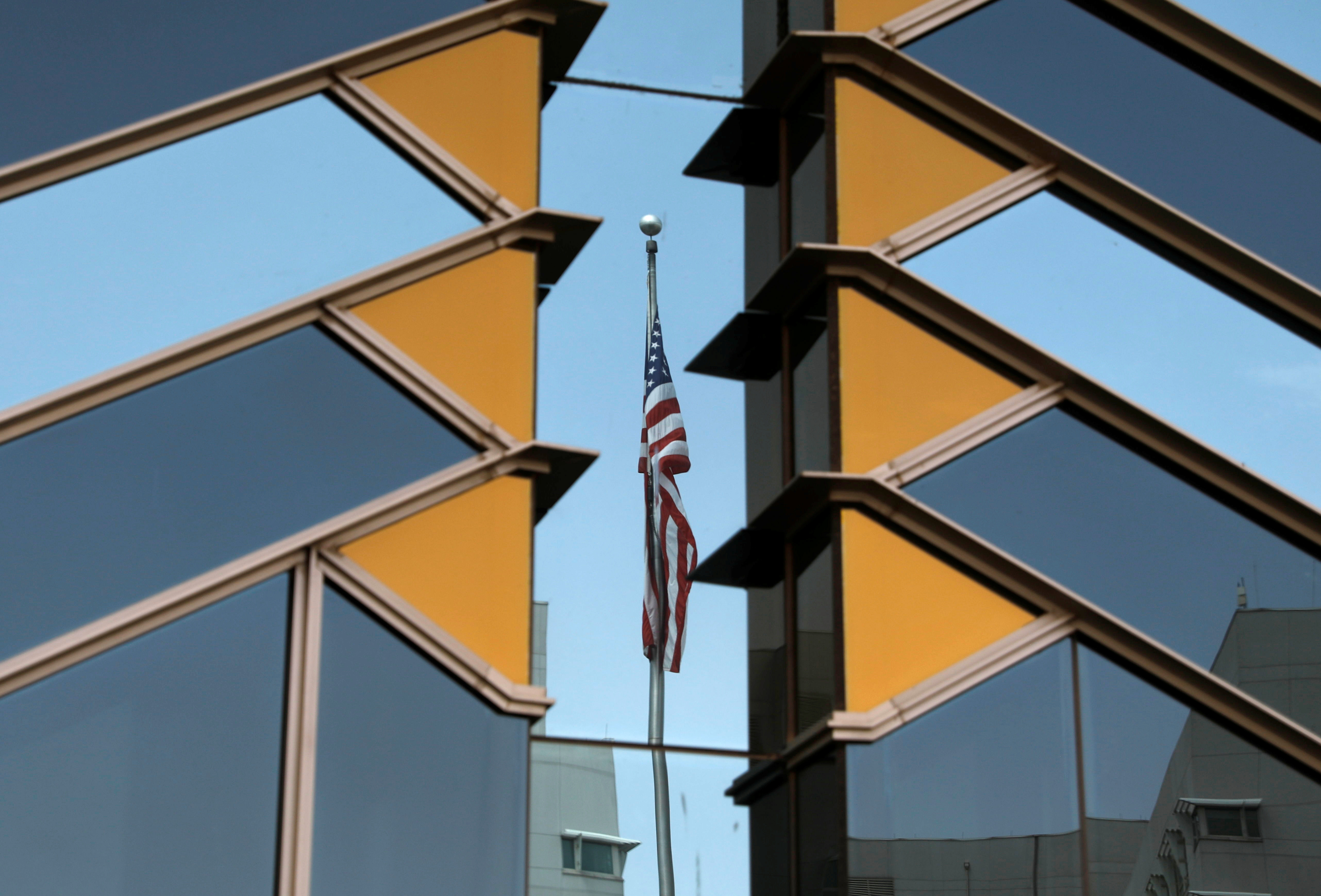 The U.S. flag is reflected on the windows of the U.S. Embassy in Kabul, Afghanistan July 30, 2021. REUTERS/Stringer