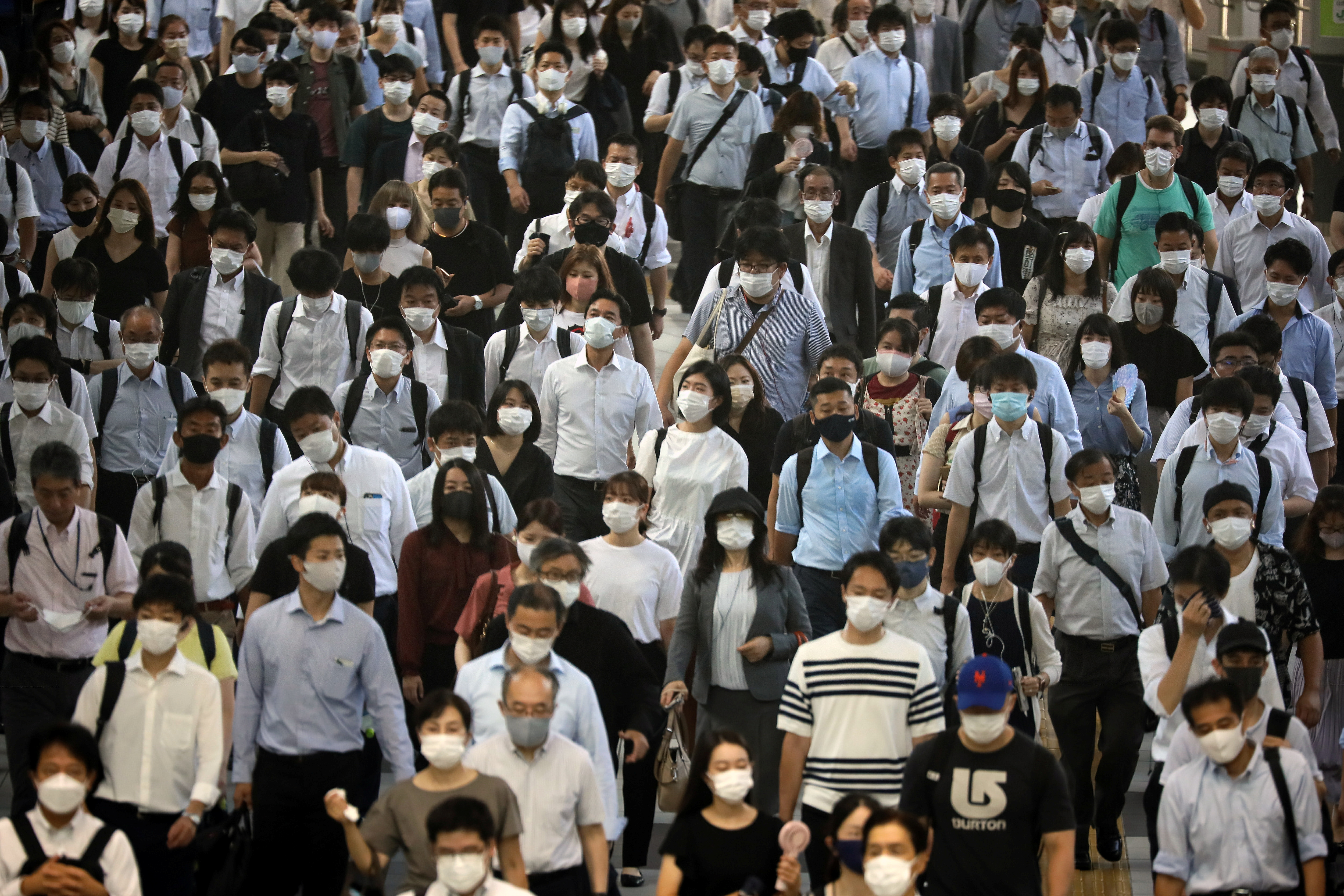 Commuters wearing face masks arrive at Shinagawa Station at the start of the working day amid the coronavirus disease (COVID-19) outbreak, in Tokyo, Japan, August 2, 2021 .REUTERS/Kevin Coombs