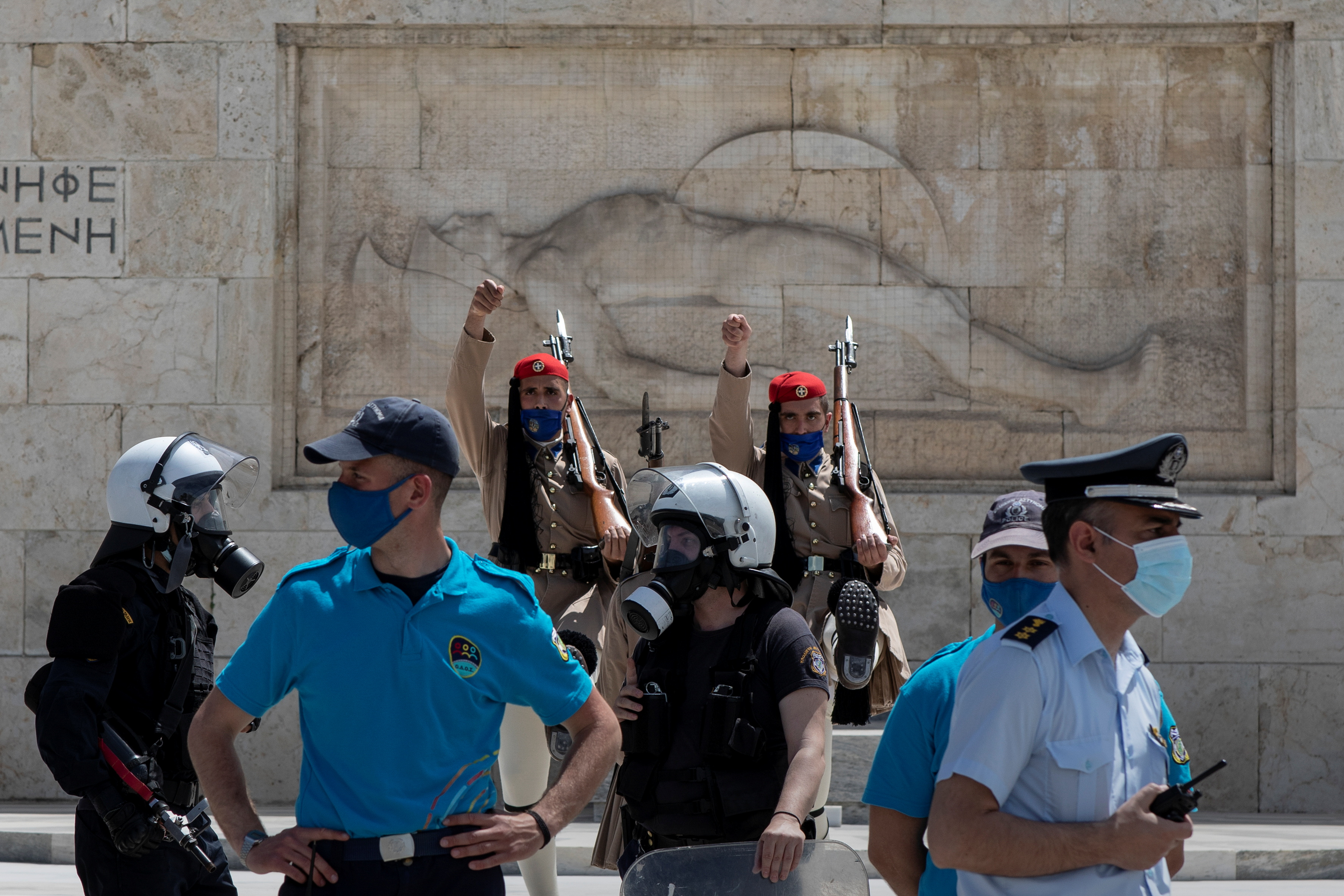 Greek Presidential Guards perform their sentry duty as police officers stand guard, during a rally organised by the communist-affiliated trade union PAME commemorating May Day, in Athens, Greece, May 6, 2021. REUTERS/Alkis Konstantinidis