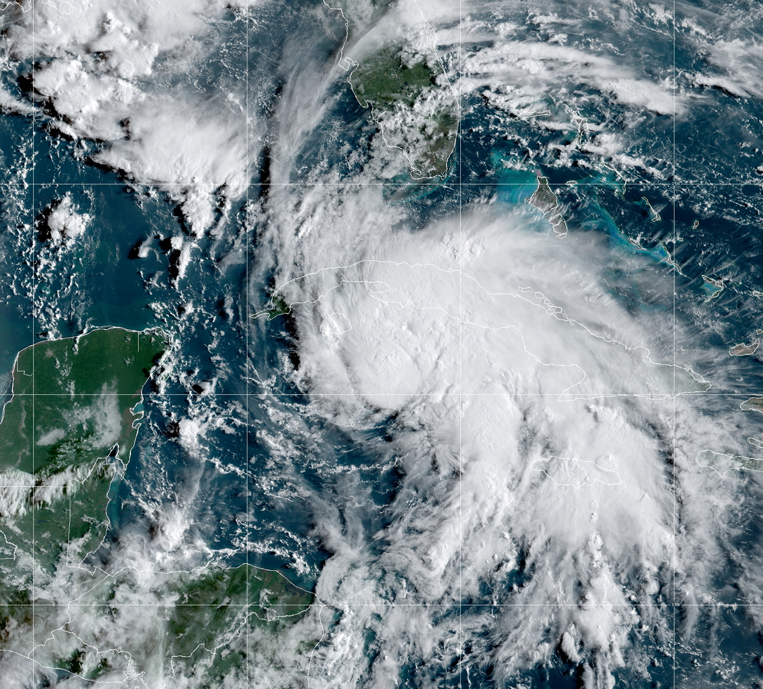 A satellite image shows Tropical Storm Ida after forming in the Caribbean, about 75 miles (125 kilometers) north-northwest of Grand Cayman, August 27, 2021. NOAA/via REUTERS