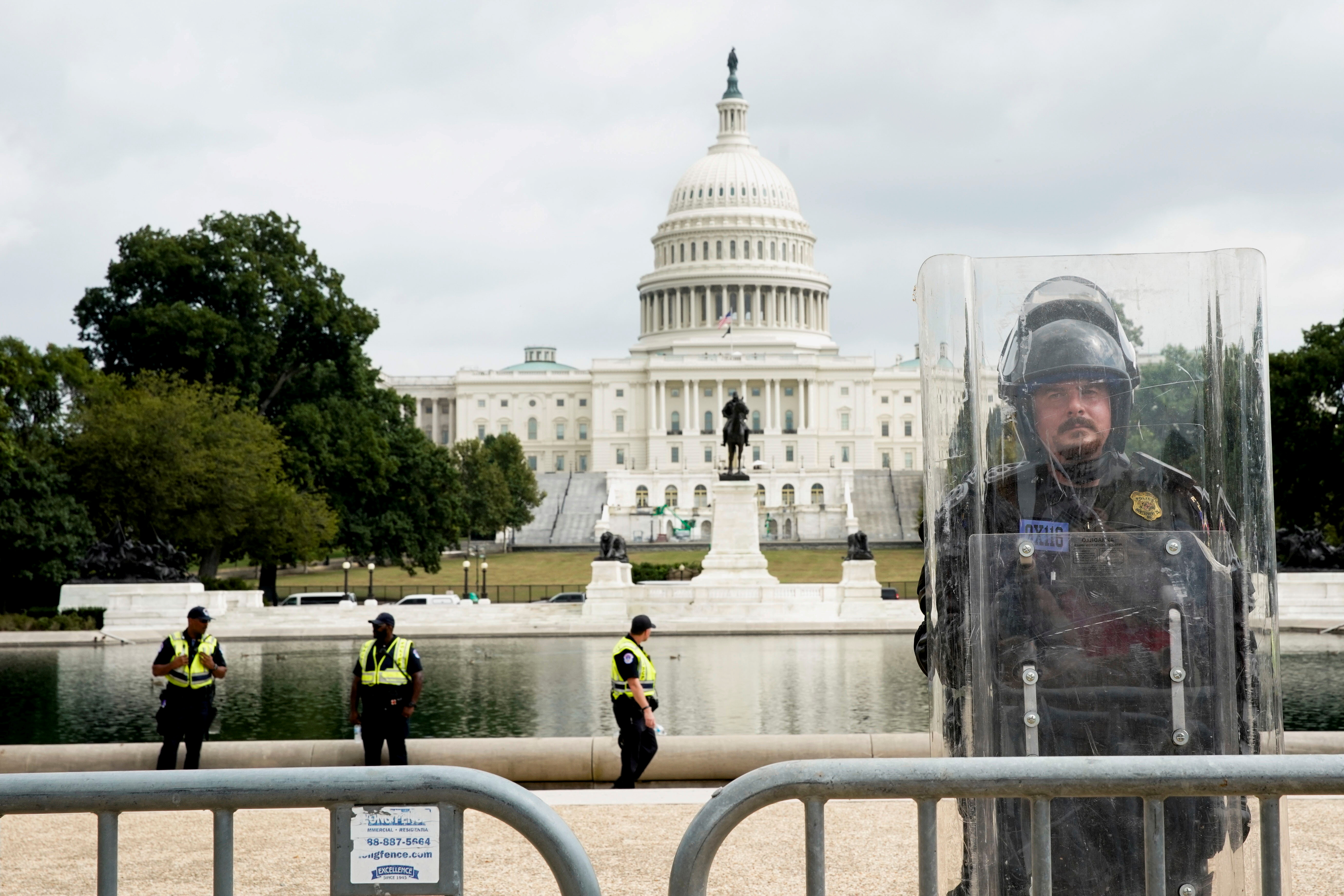 A riot police officer stands guard during a rally in support of defendants being prosecuted in the January 6 attack on the Capitol. REUTERS/Elizabeth Frantz/File Photo