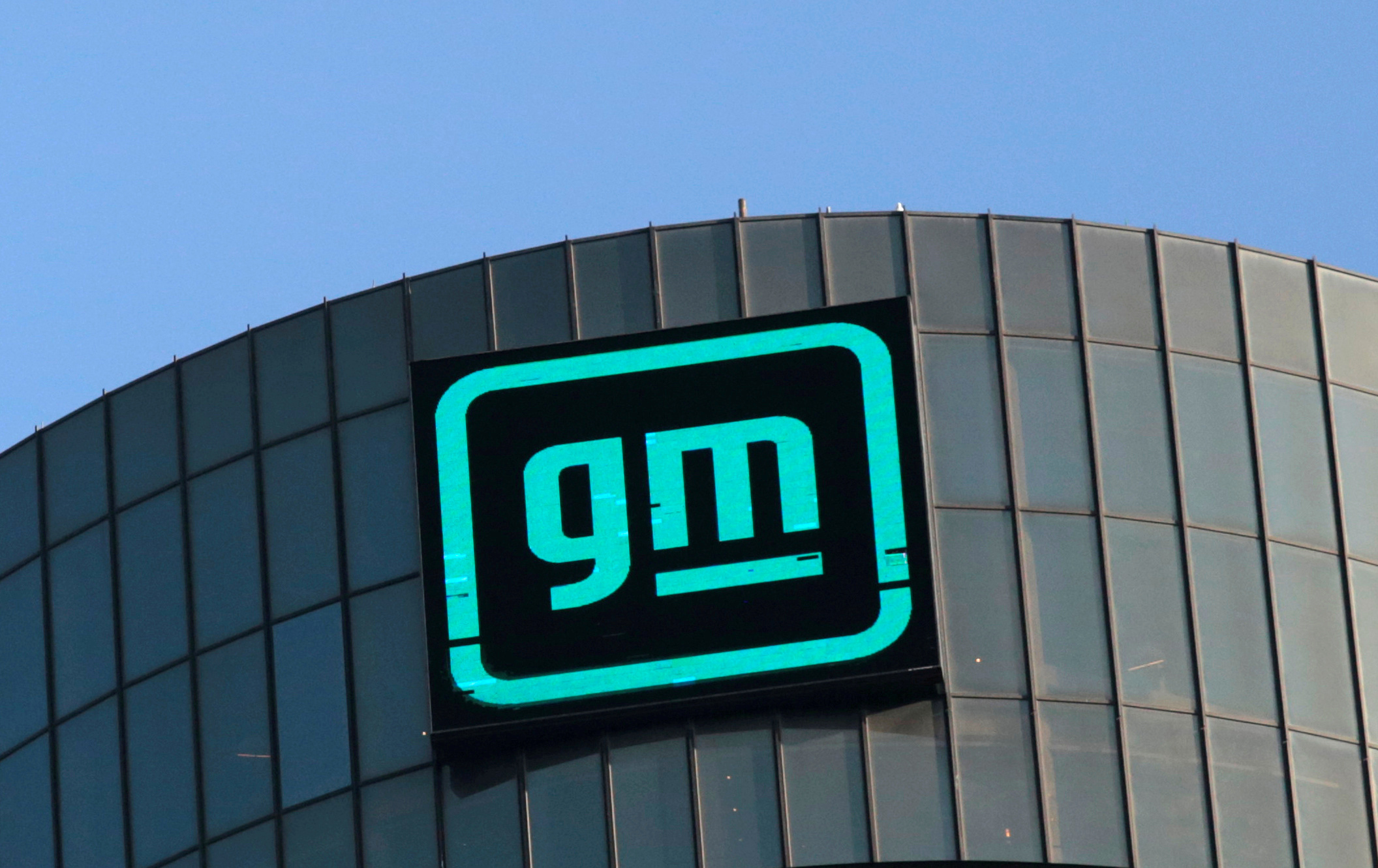 The new GM logo is seen on the facade of the General Motors headquarters in Detroit, Michigan, U.S., March 16, 2021. Picture taken March 16, 2021.  REUTERS/Rebecca Cook