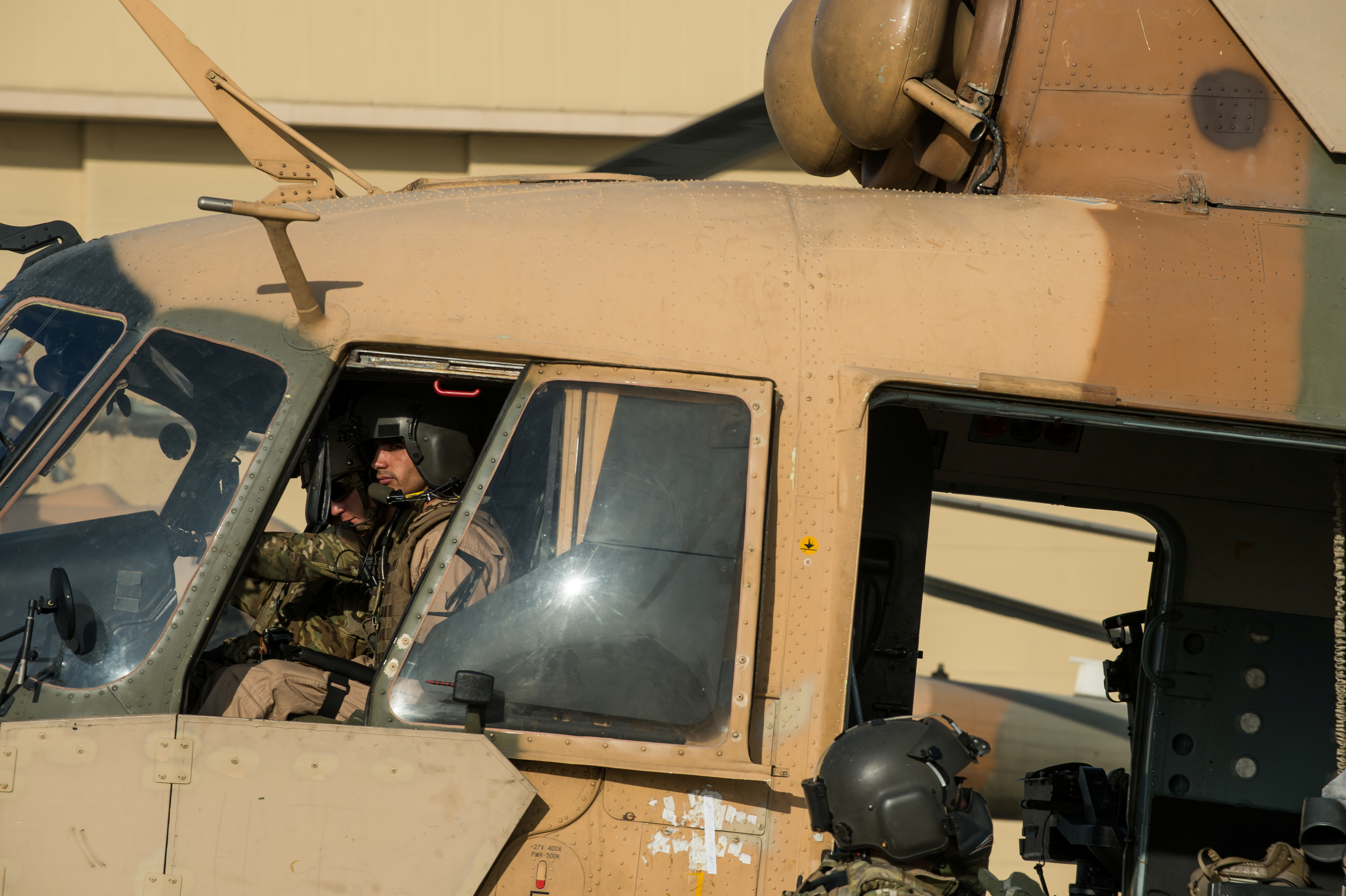An Afghan Air Force Mi-17 helicopter pilot prepares to depart, to be the air support for the final scenario of Air Liaison Officer School, at Kabul International Airport, Afghanistan November 25, 2014. Picture taken November 25, 2014. To match Special Report USA-AFGHANISTAN/PILOTS     U.S. Air Force/Staff Sgt. Perry Aston/Handout via REUTERS