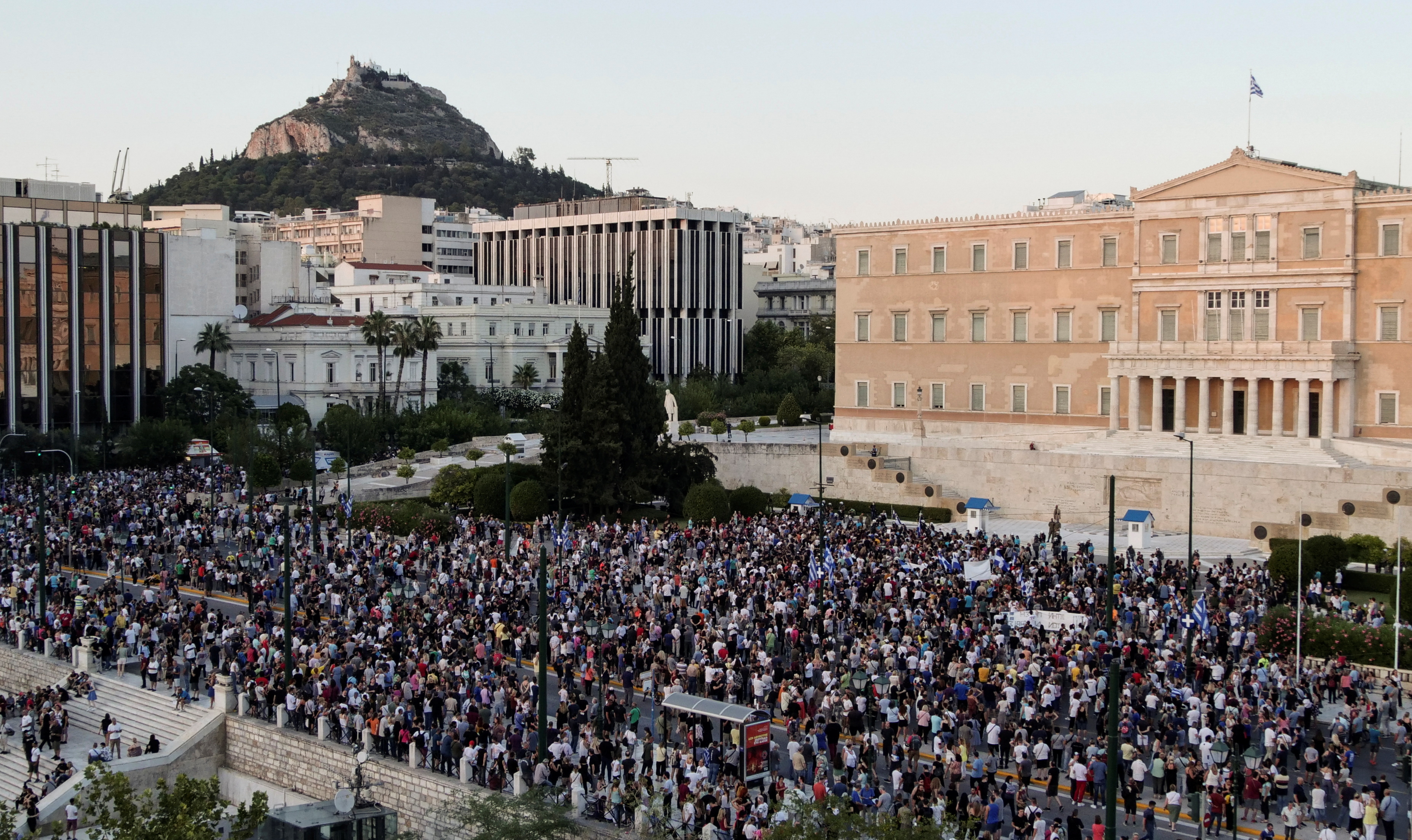 Anti-vaccine protesters take part in a demonstration outside the parliament building after the government announced mandatory vaccinations for certain sectors, in Athens, Greece, July 14, 2021. REUTERS/Vassilis Triandafyllou
