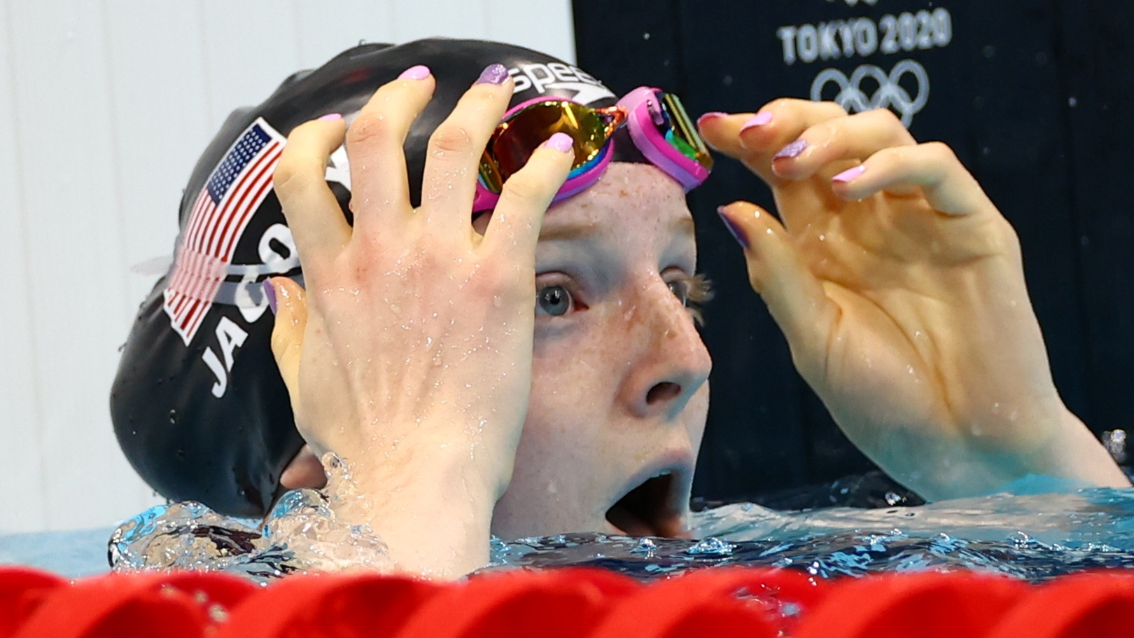 Tokyo 2020 Olympics - Swimming - Women's 100m Breaststroke - Final - Tokyo Aquatics Centre - Tokyo, Japan - July 27, 2021.  Lydia Jacoby of the United States reacts after winning the gold medal REUTERS/Kai Pfaffenbach